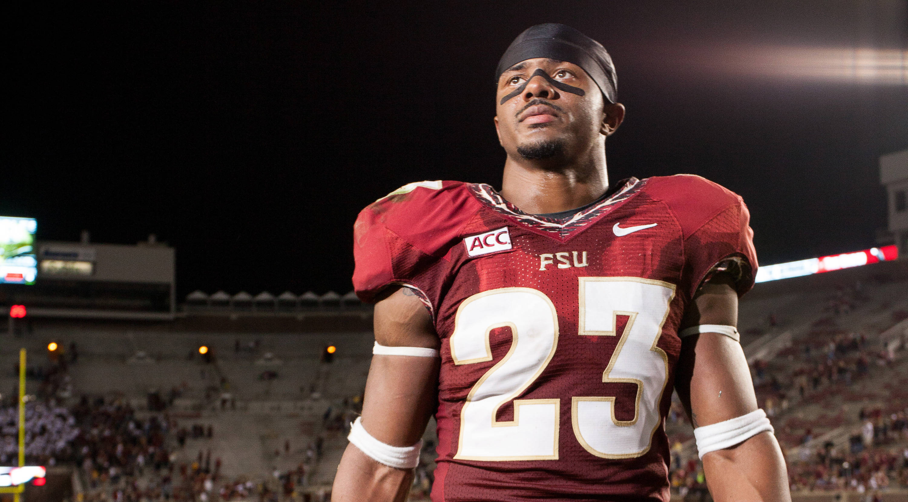 Gerald Demps (23) walks off the field after his final home game as a senior, FSU's 80-14 victory over Idaho, in Tallahassee, Fla on Saturday, November 23, 2013. Photos by Mike Schwarz.