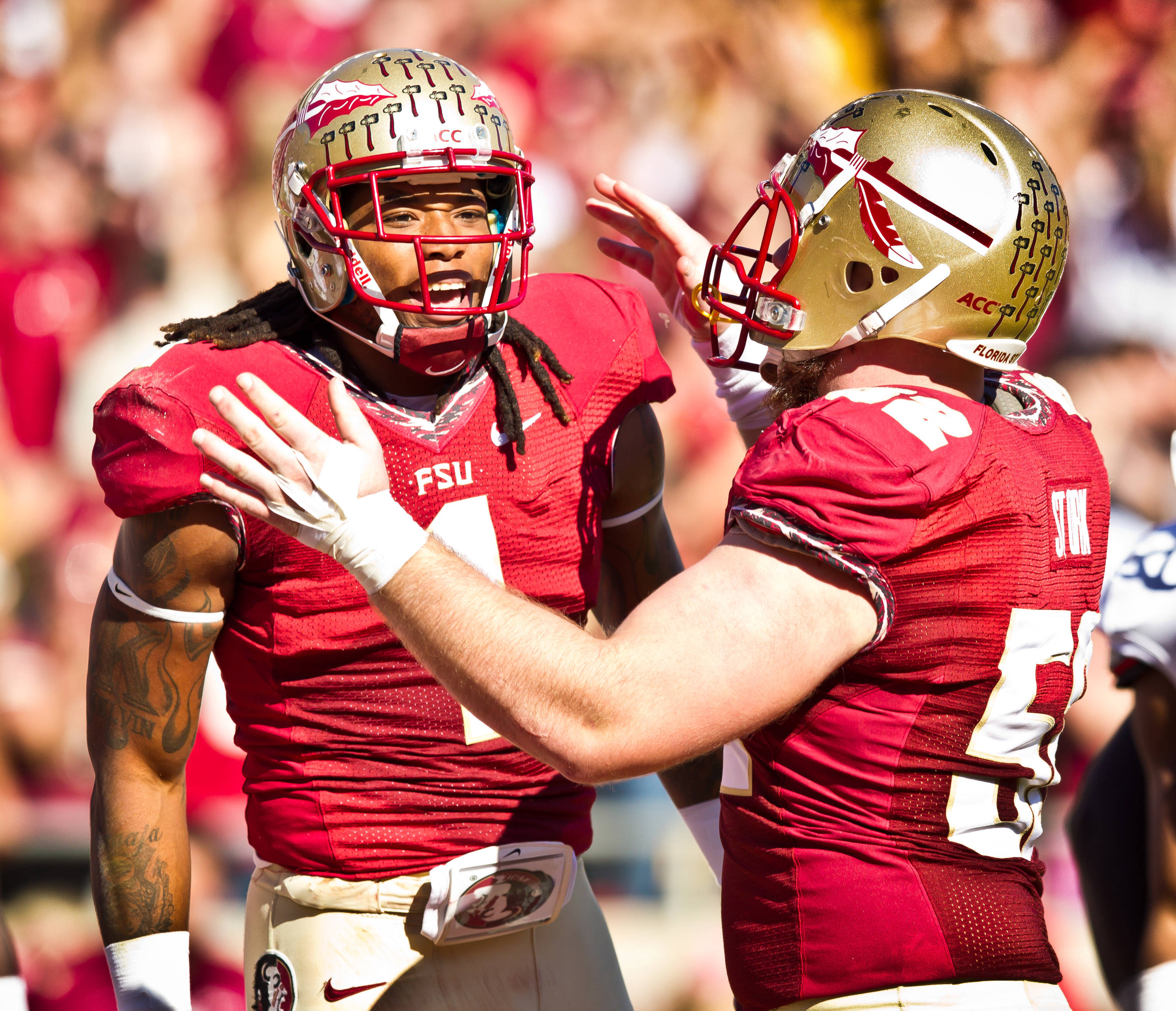 Kelvin Benjamin (1) is congratulated by  Bryan Stork (52) after his 1st quarter touchdown reception.