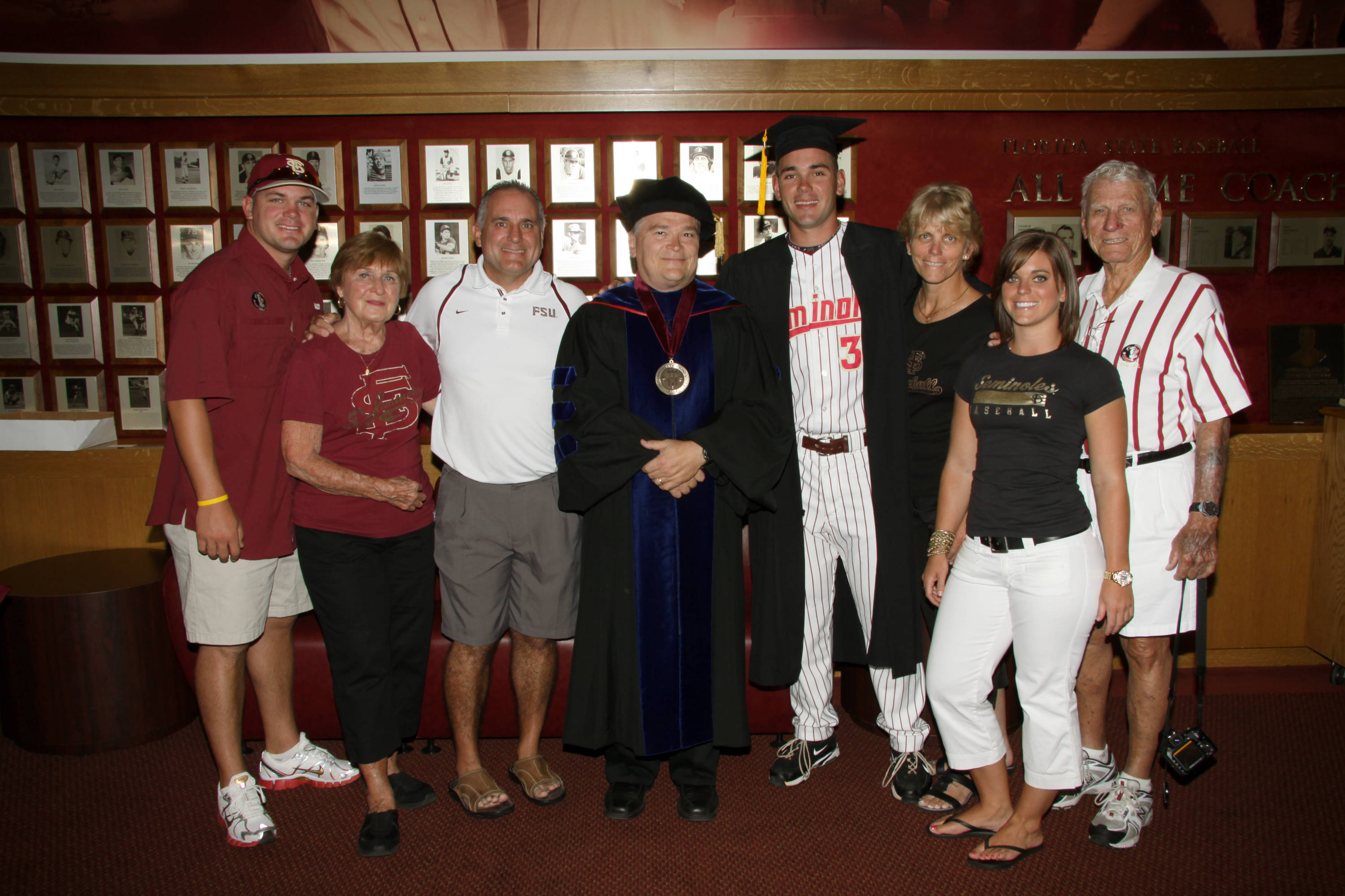 2011 Spring Graduation Ceremony held at Dick Howser Stadium to honor the graduating baseball seniors. Robby Scott (36) with family and President Barron