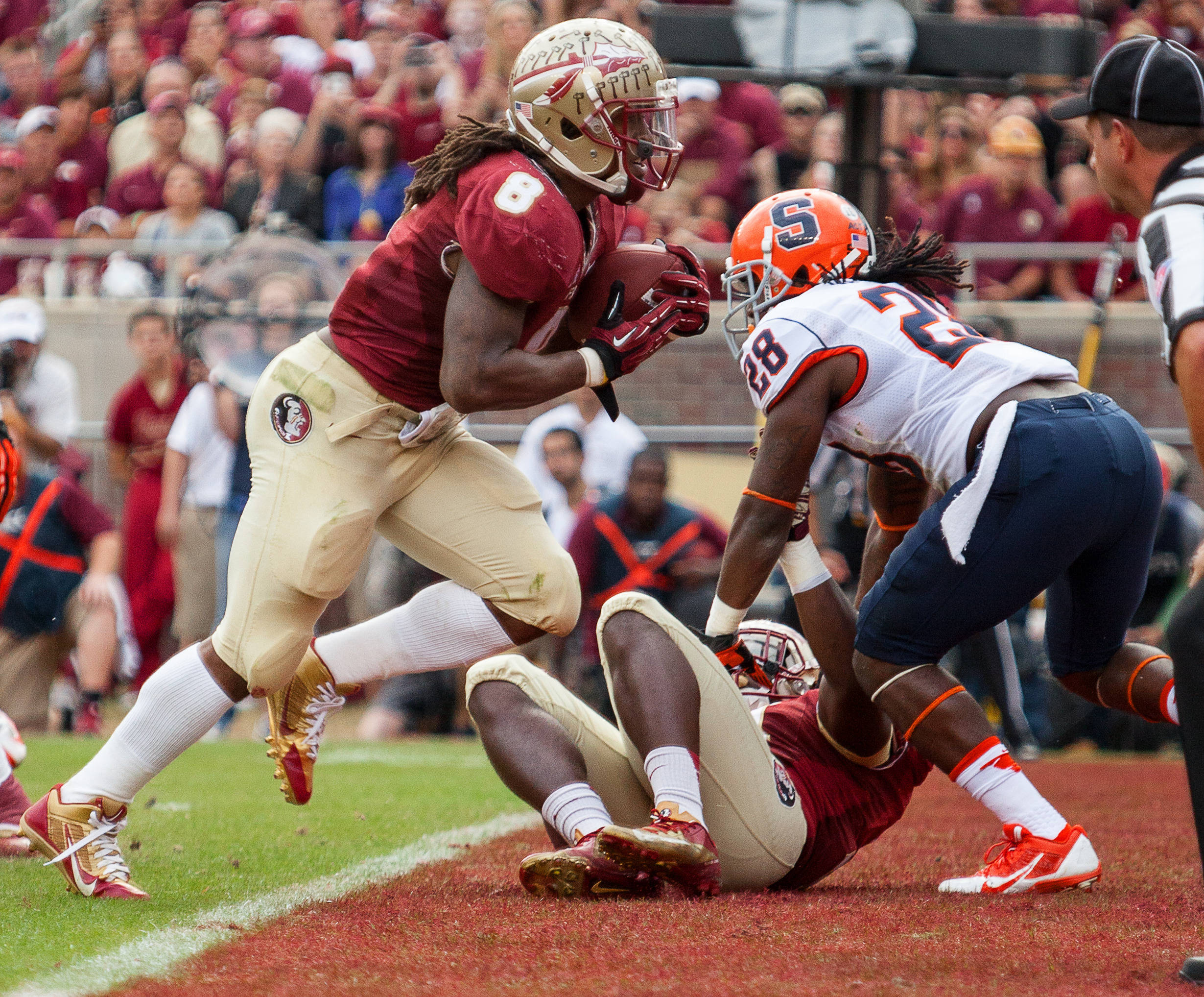 Devonta Freeman (8) scores a touchdown during FSU Football's 59-3 win over Syracuse on Saturday, November 16, 2013 in Tallahassee, Fla. Photo by Mike Schwarz.