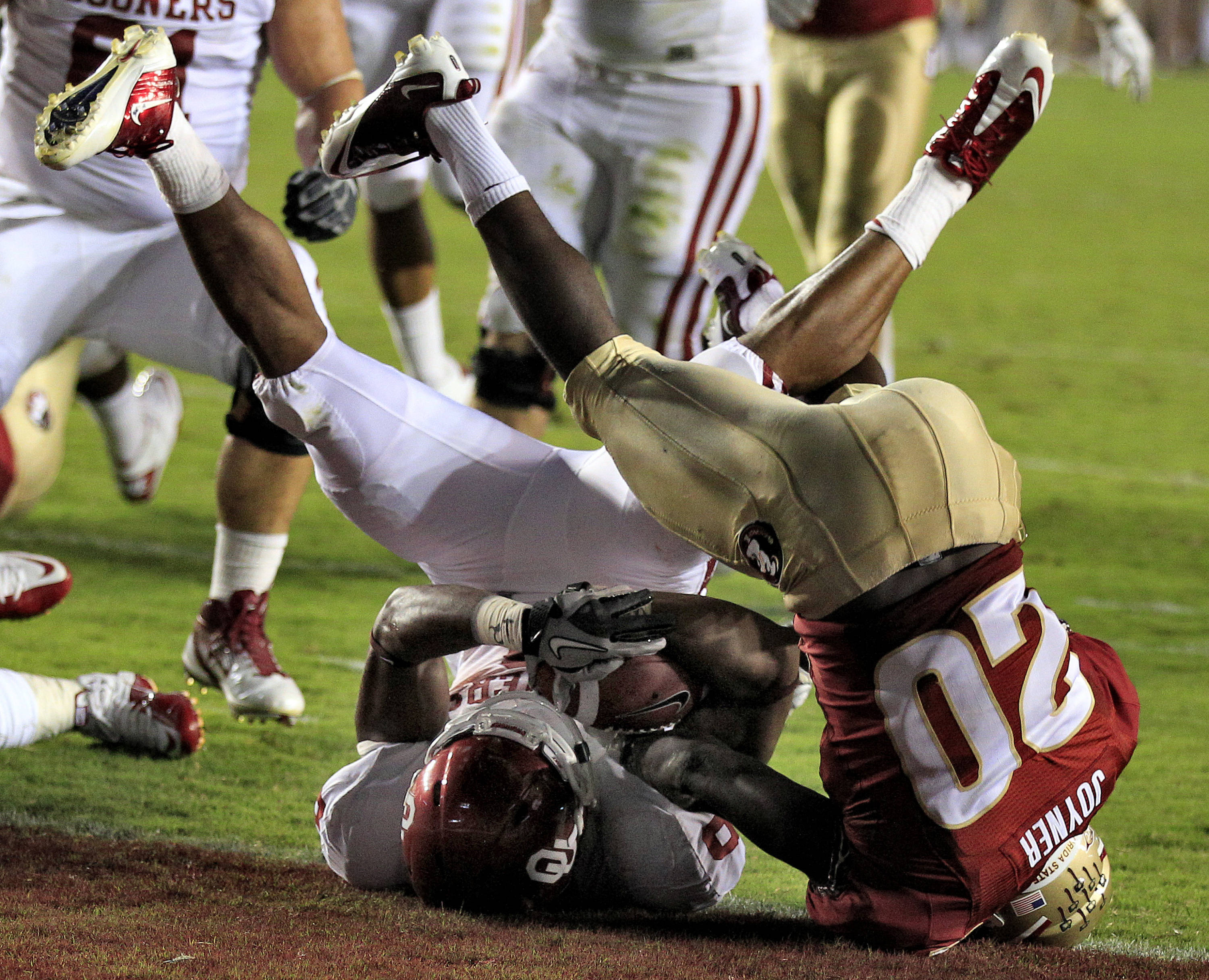 Oklahoma running back Dominique Whaley (8) is upended by Florida State safety Lamarcus Joyner (20) at the goal line during the first quarter. (AP Photo/Chris O'Meara)
