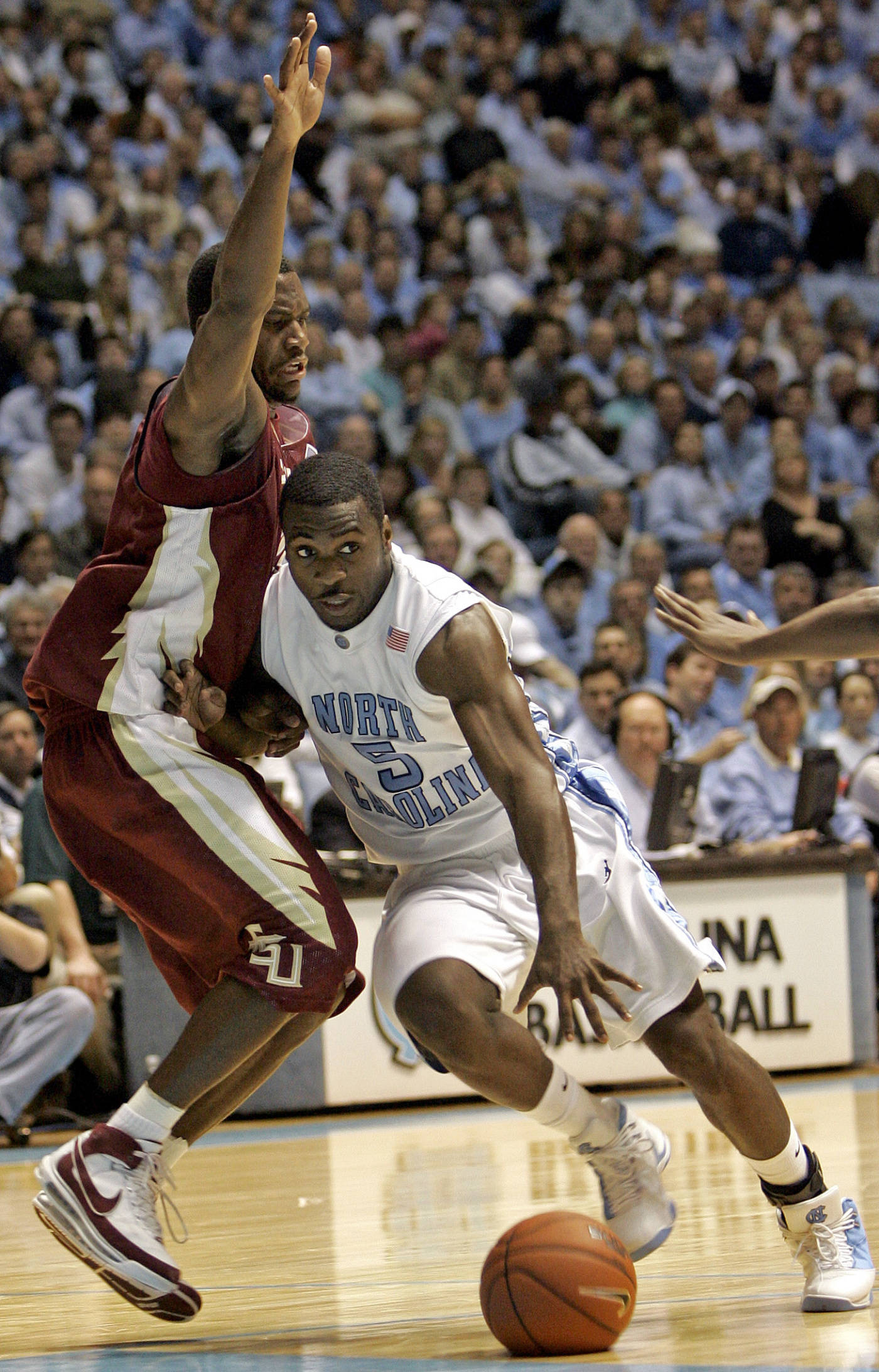 North Carolina's Ty Lawson (5) drives past Florida State's Toney Douglas during the first half of a college basketball game in Chapel Hill, N.C., Tuesday, March 4, 2008. North Carolina won 90-77. (AP Photo/Gerry Broome)