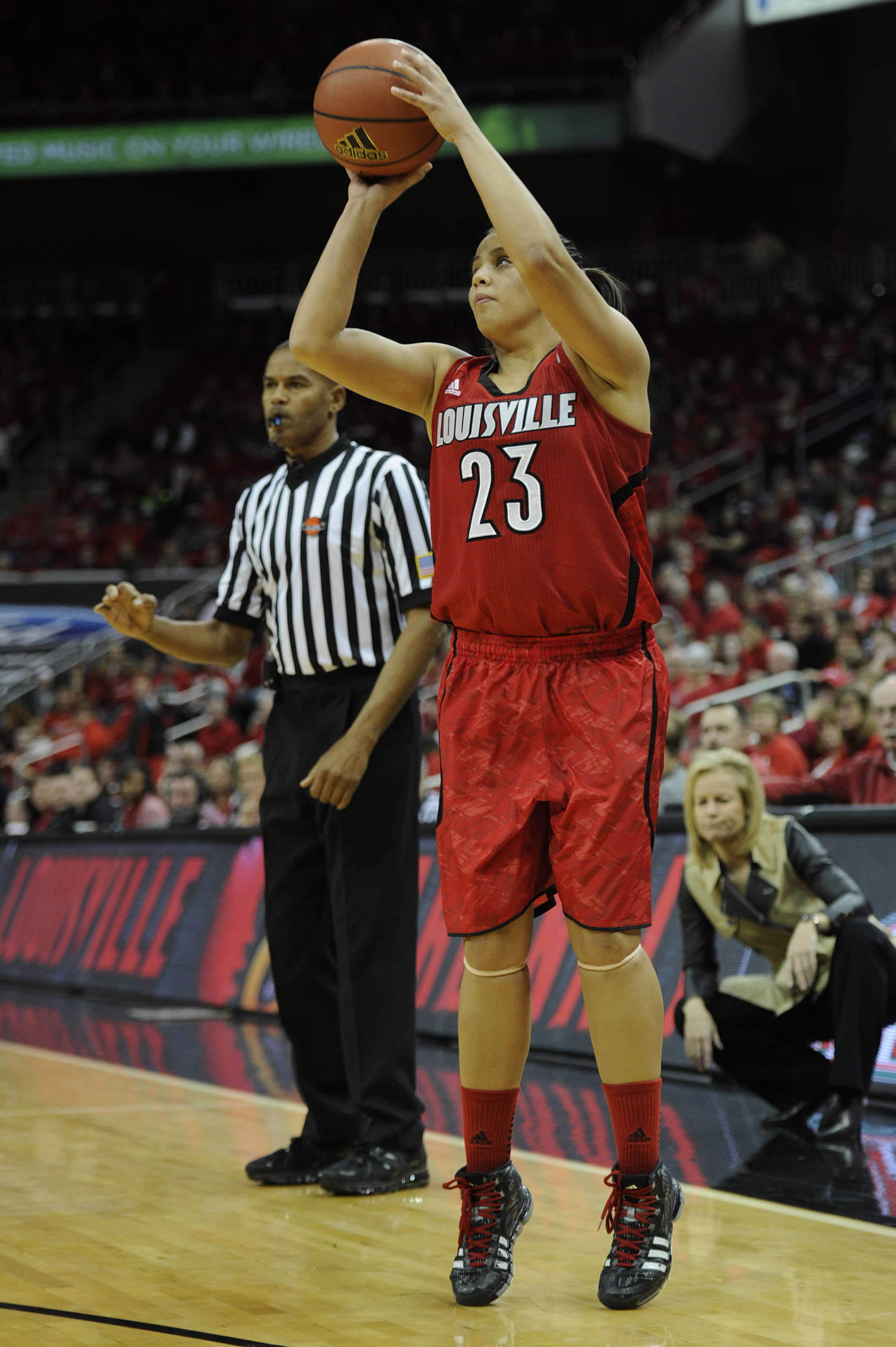 Nov 24, 2013; Louisville, KY, USA; Louisville Cardinals guard Shoni Schimmel (23) shoots against the Florida State Seminoles during the first half at KFC YUM! Center. Mandatory Credit: Jamie Rhodes-USA TODAY Sports