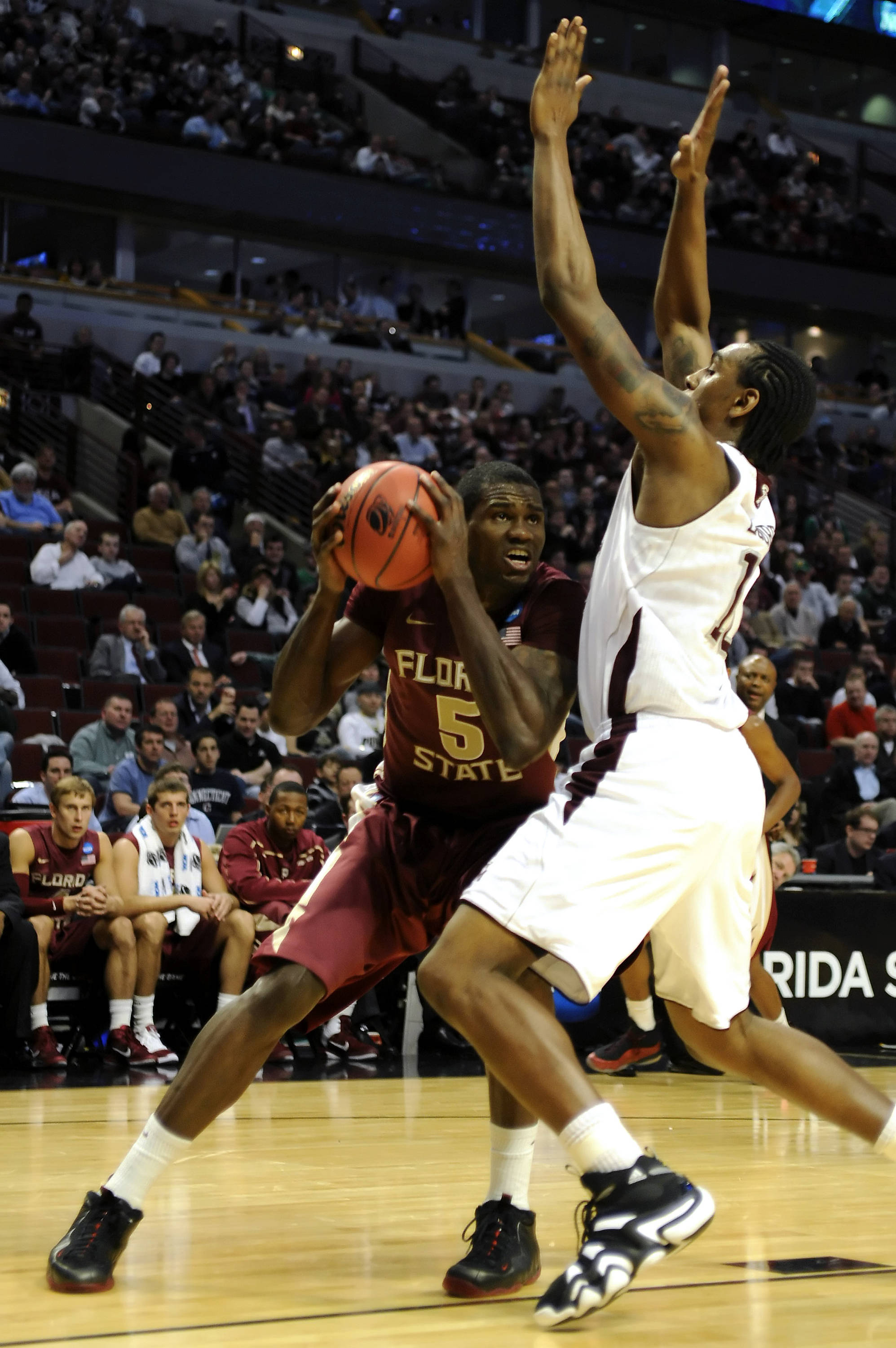 Bernard James looks for an opening to shoot against the Aggies