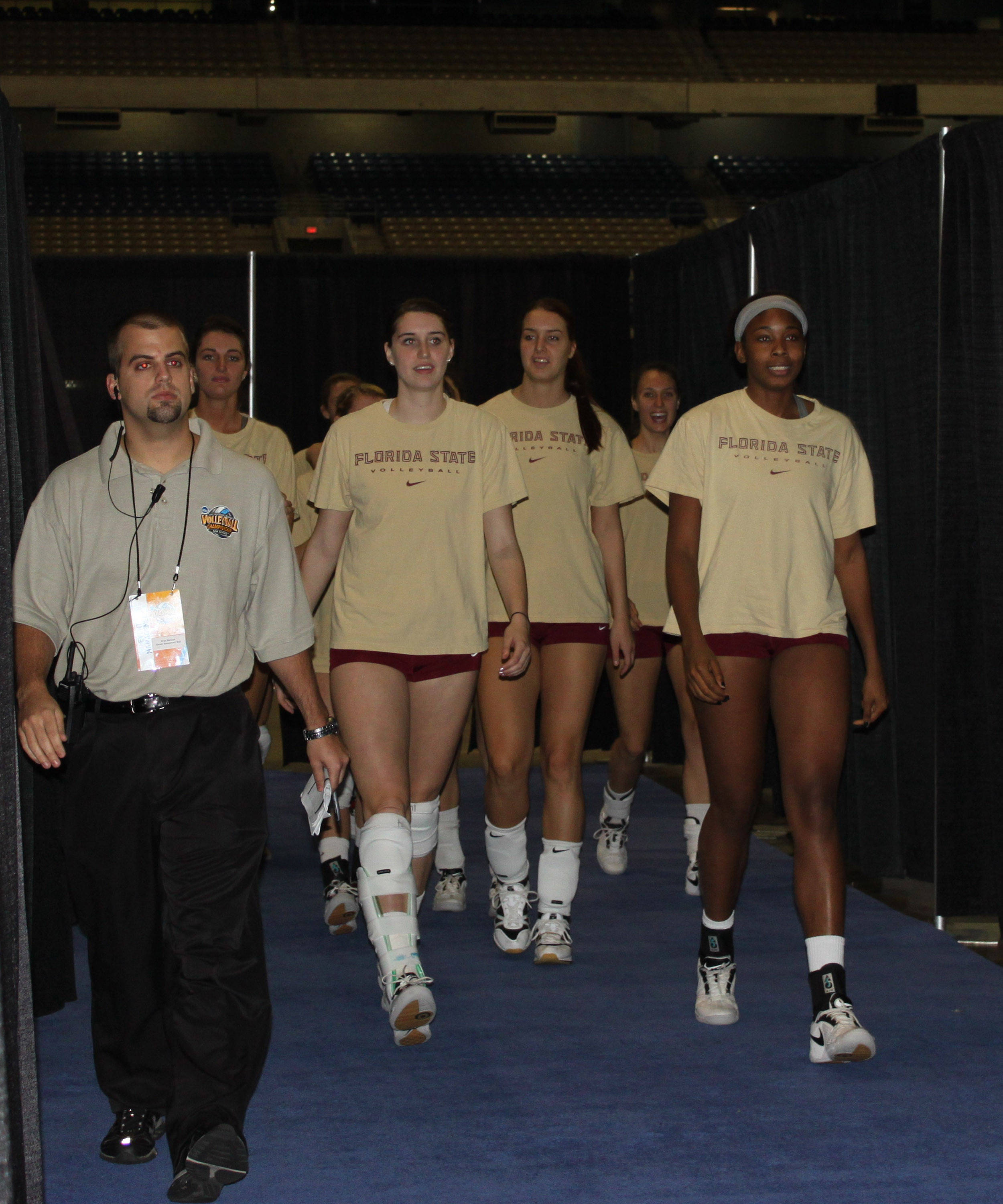 Team walks out of the court