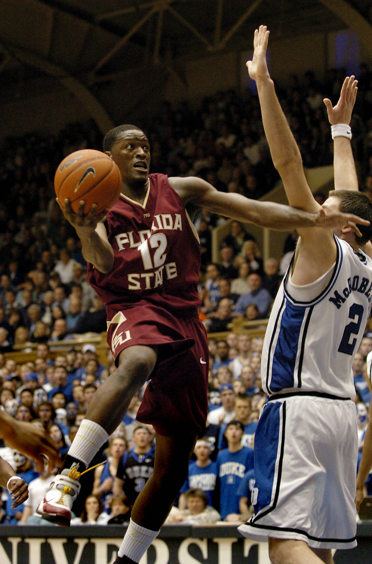 Florida State's Al Thorton (12) drives toward the basket over Duke's Josh McRoberts (2) in the second half of a basketball game in Durham, N.C., on Sunday, Feb. 4, 2007. Thornton led his team with 21 points. Florida State upset Duke, 68-67. (AP Photo/Sara D. Davis)