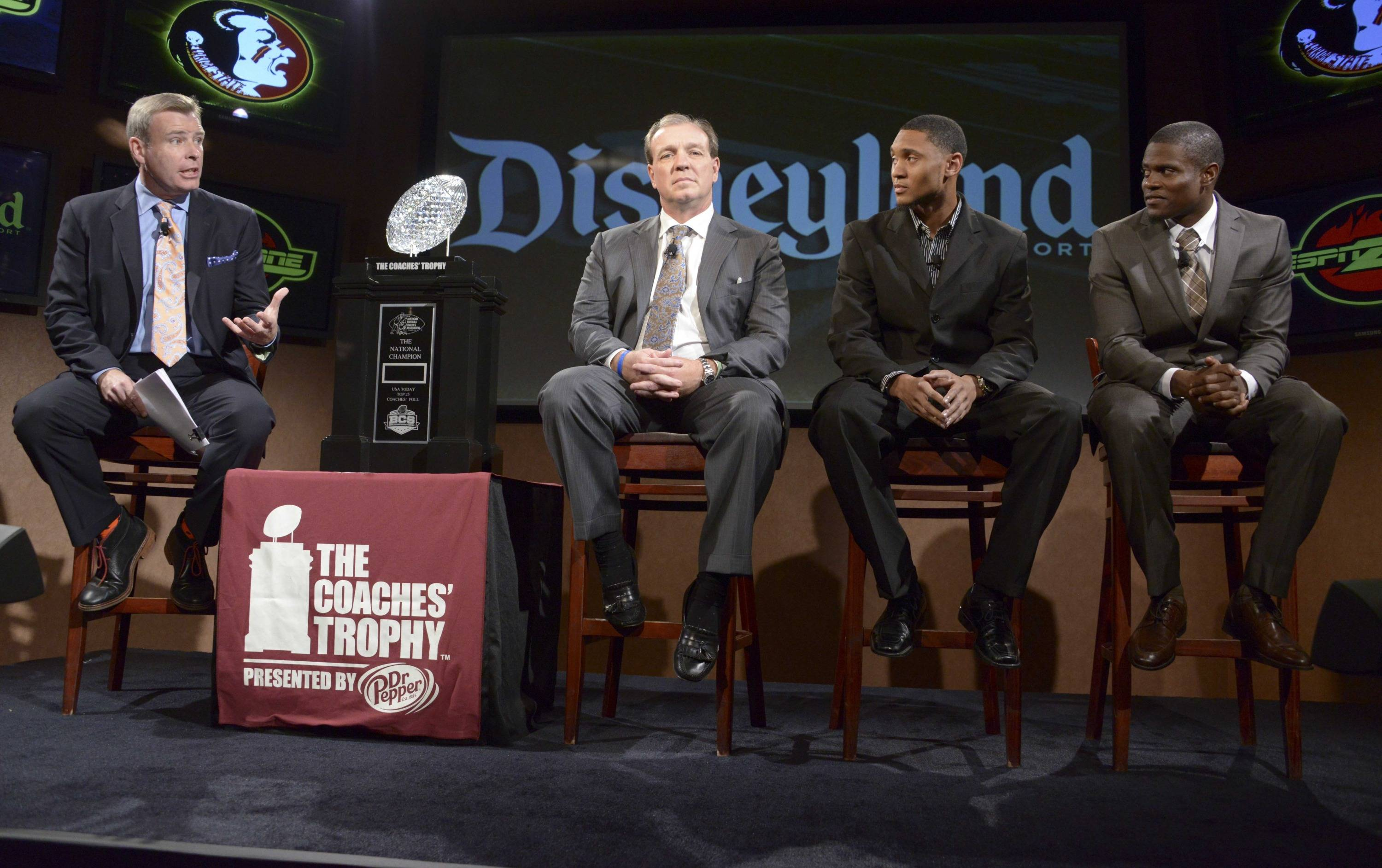ESPN broadcaster Tom Rinaldi (left) interviews Florida State Seminoles coach Jimbo Fisher (second from left) and receiver Rashad Greene (second from right) and defensive back Lamarcus Joyner at a press conference for the 2014 BCS National Championship at ESPN Zone Downtown Disney. Mandatory Credit: Kirby Lee-USA TODAY Sports