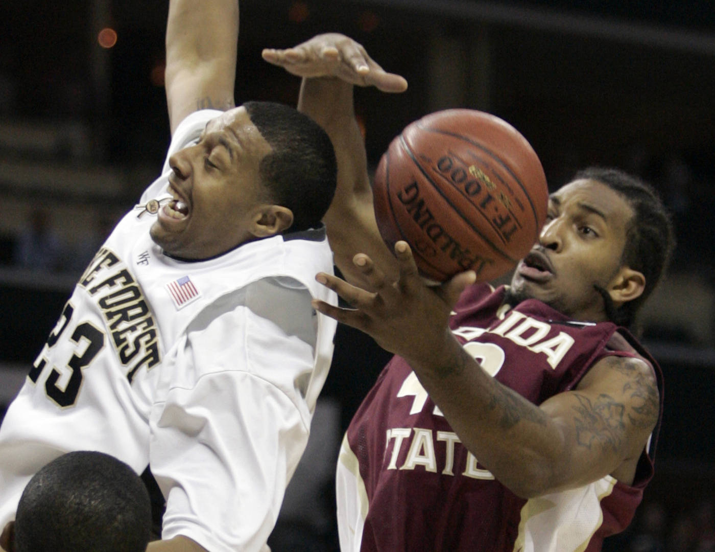 Ryan Reid pulls in a rebound over Wake Forest's James Johnson in the second half. (AP Photo/Steve Helber)