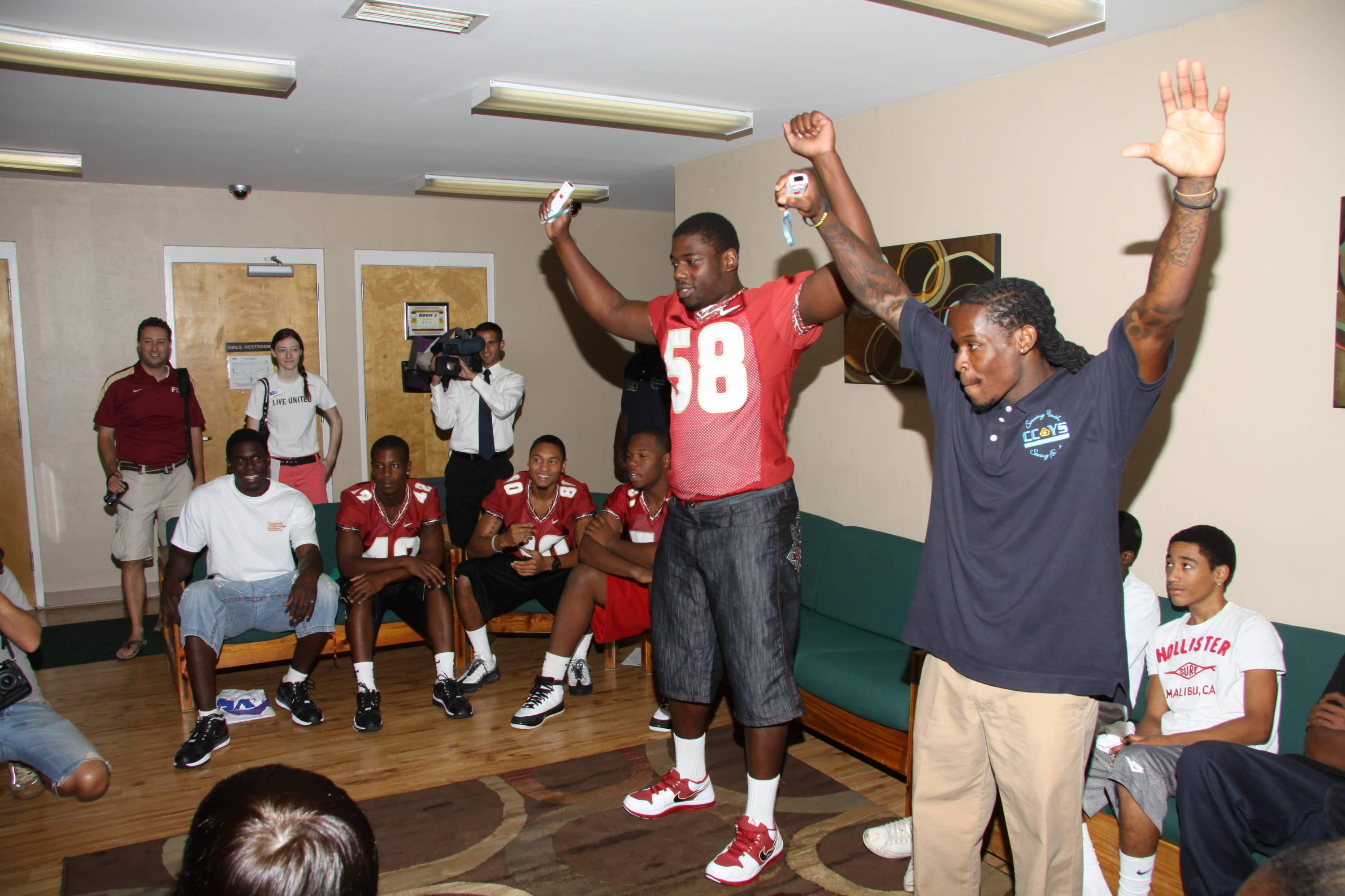 Dan Hicks plays Wii at Capital City Youth Services as part of FSU's Day of Doing.