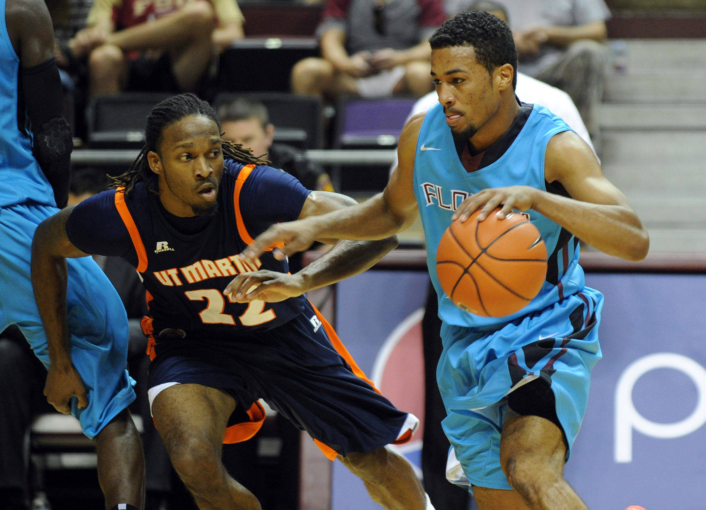 Devon Bookert (1) moves around UT Martin Skyhawks guard Justin Childs (22) during the first half at Donald L. Tucker Center. Mandatory Credit: Melina Vastola-USA TODAY Sports
