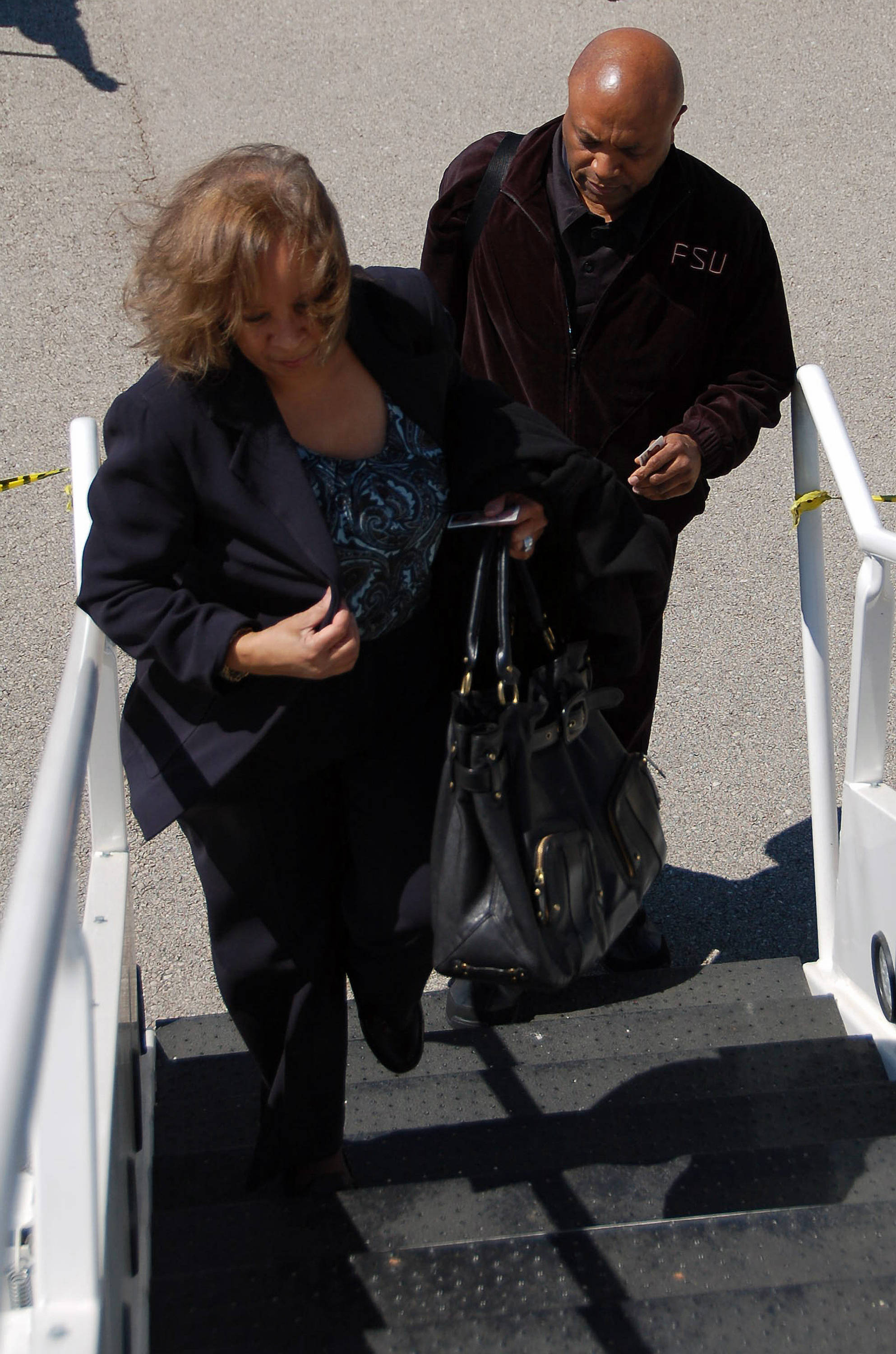 Leonard Hamilton and his wife board the plane in Tallahassee