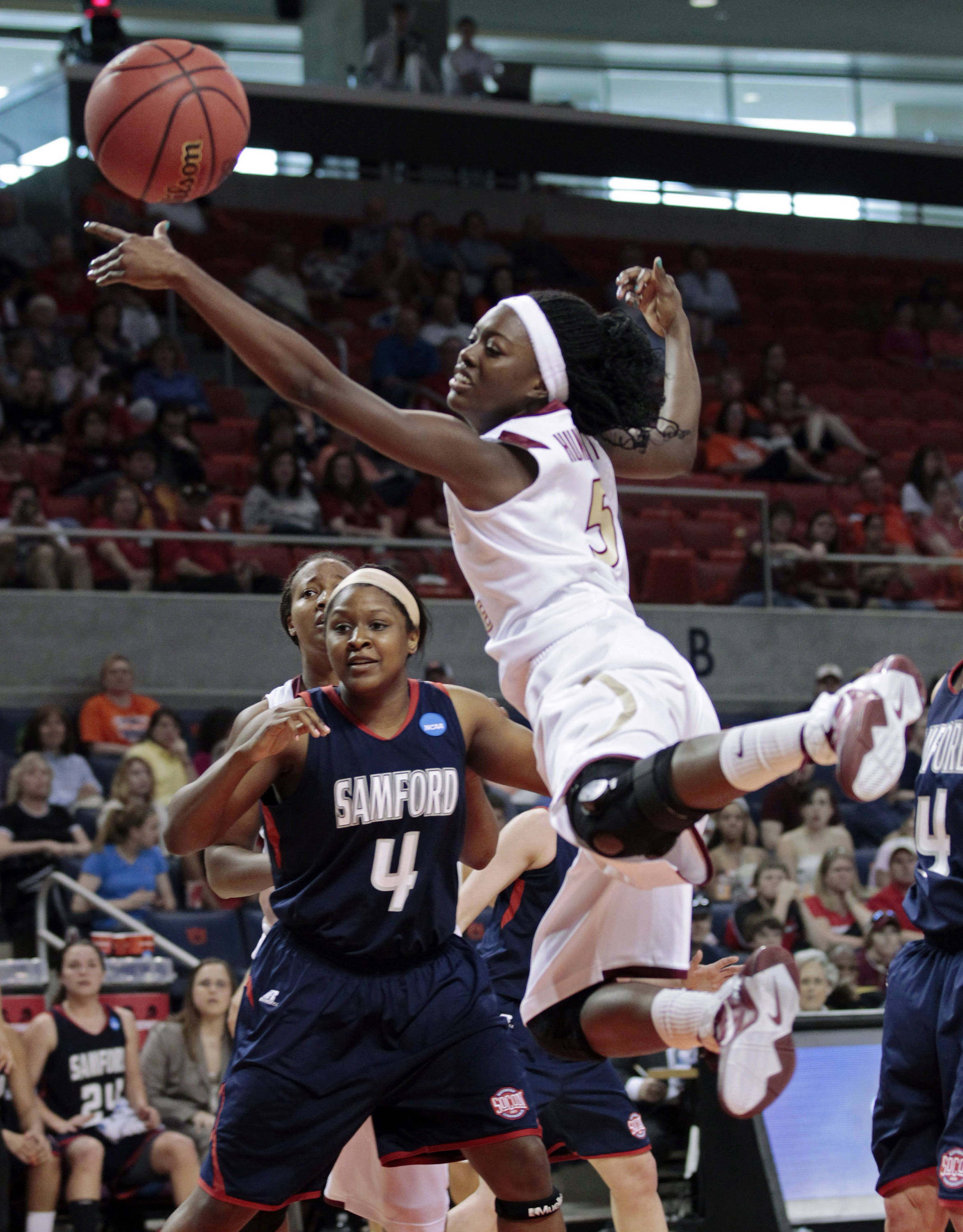 Florida State guard Christian Hunnicutt goes to the basket as Samford's J'Quita Babineaux defends in the first half. (AP Photo/Dave Martin)