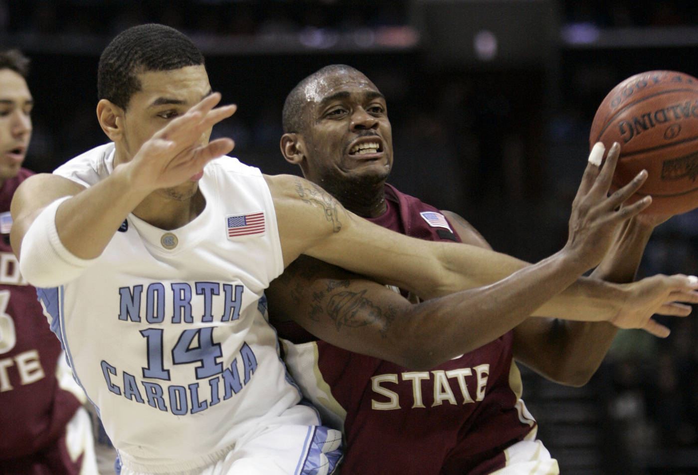 North Carolina's Danny Green collides with Ralph Mims in the first half. (AP Photo/Steve Helber)