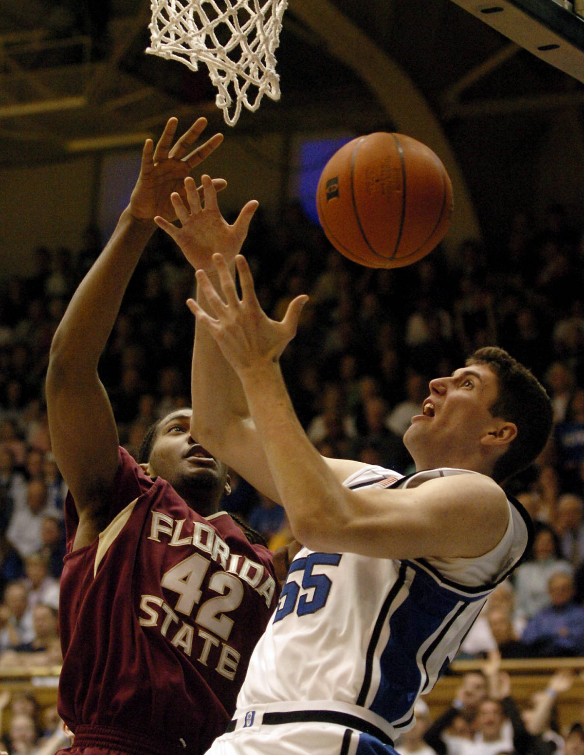 Duke's Brian Zoubek (55) battles for a loose ball under the basket with Florida State's Ryan Reid (42) in the first half of a basketball game in Durham, N.C., on Sunday, Feb. 4, 2007. (AP Photo/Sara D. Davis)
