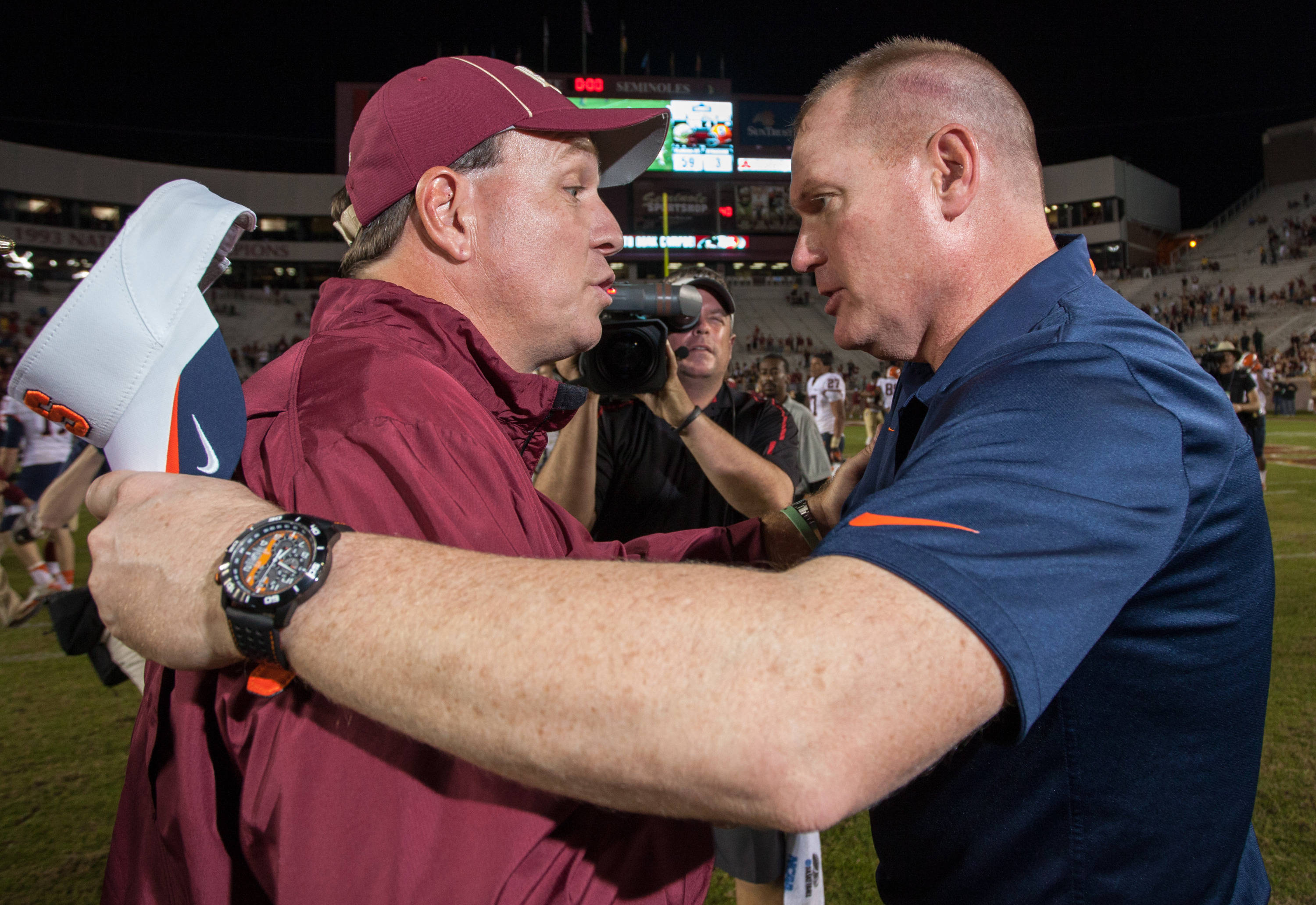 Jimbo Fisher shakes hands with Scott Shafer during FSU Football's 59-3 win over Syracuse on Saturday, November 16, 2013 in Tallahassee, Fla. Photo by Mike Schwarz.