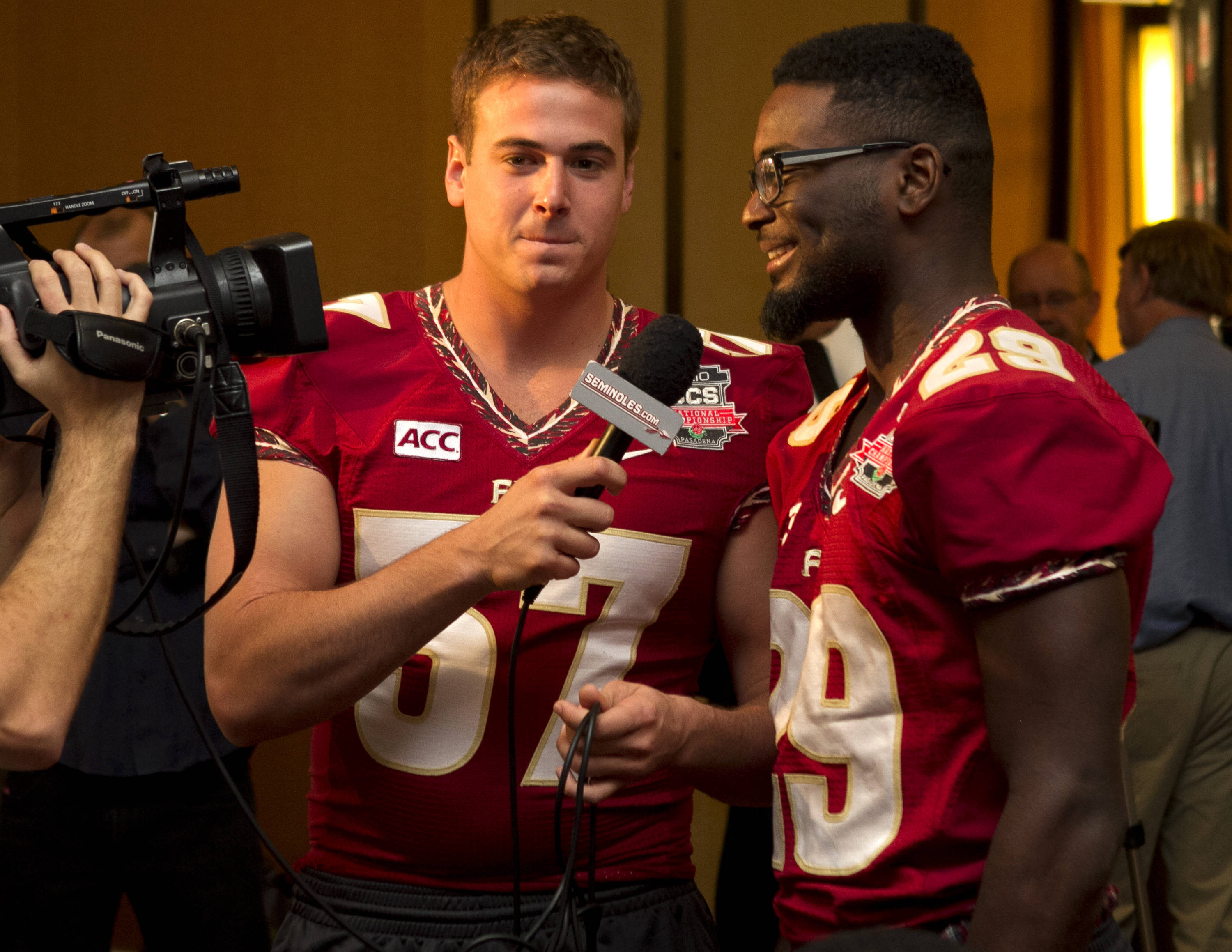 Philip Doumar (57) interviewing Nate Andrews (29), FSU at BCS Championship Media Day,  1-04-14,  (Photo by Steve Musco)