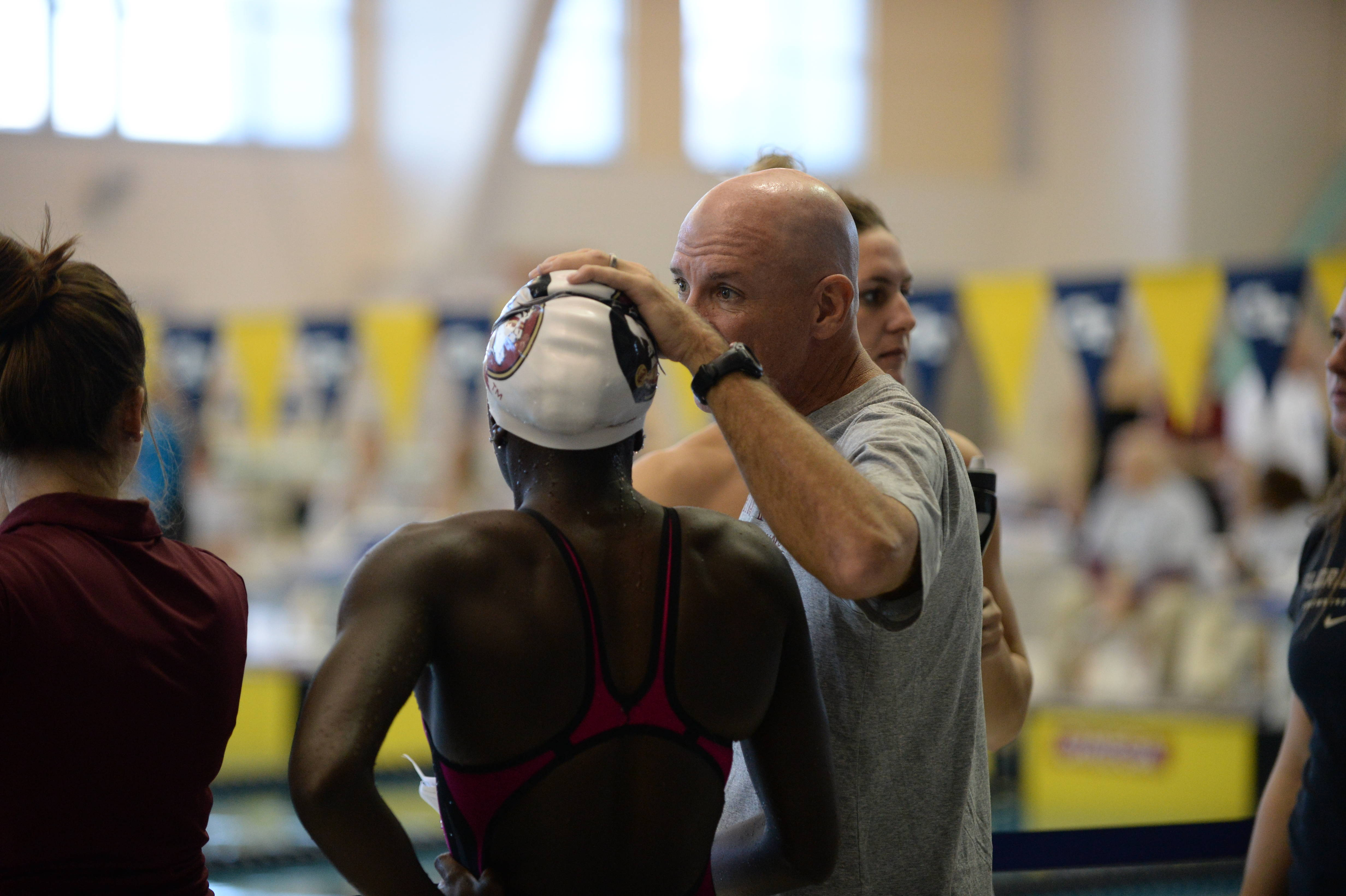 Coach Andy Robins talks with Alexi Smith before her race - Mitch White