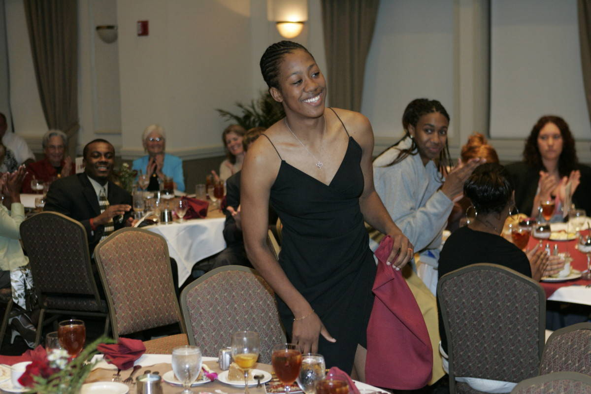 Alicia Gladden heads up to the stage for another award.