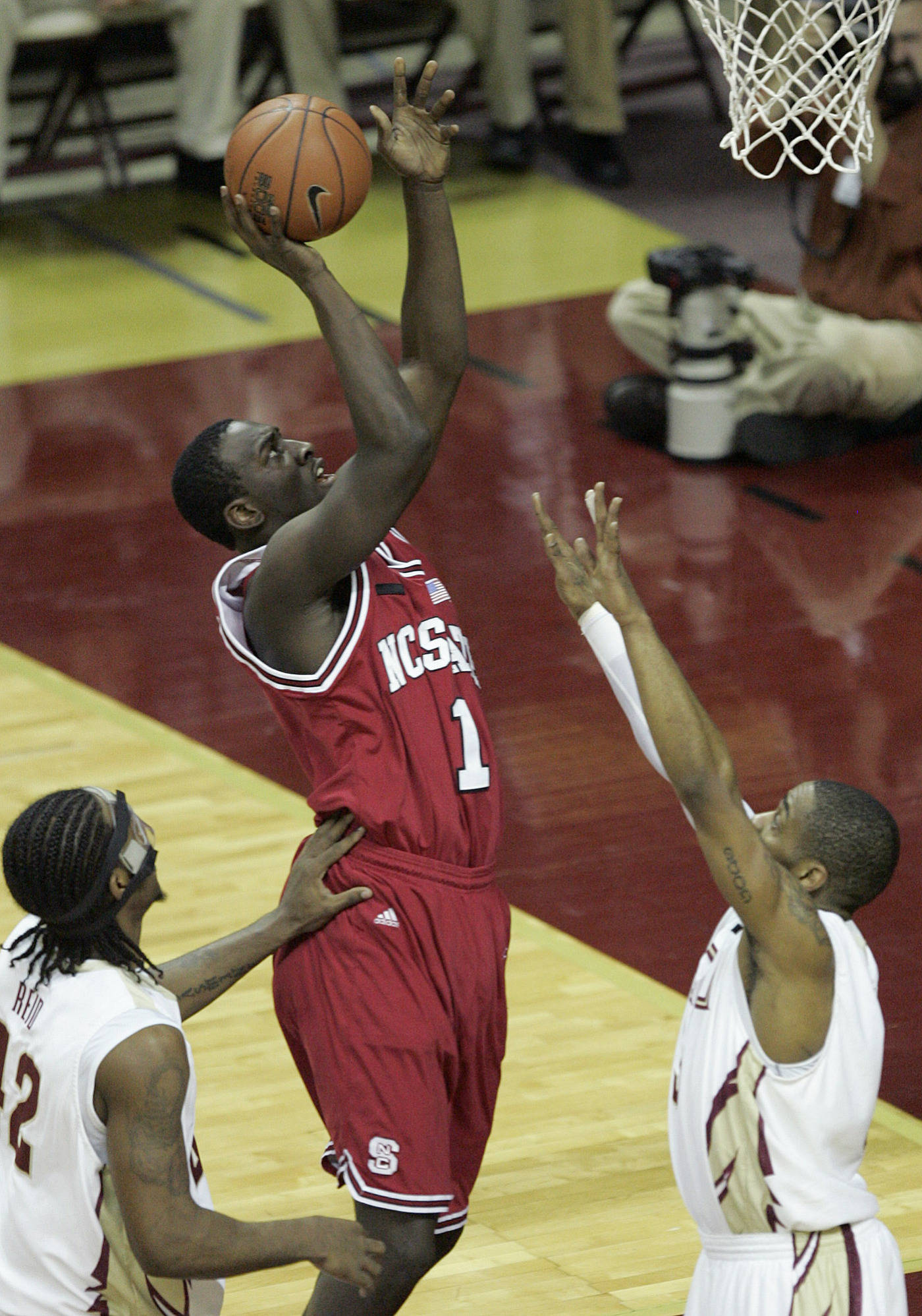 North Carolina State's J J Hickson shoots and scores past Florida State defenders Ryan Reid, left and Isaiah Swann in the first half of a college basketball game on Saturday, Jan. 26, 2008 in Tallahassee, Fla.