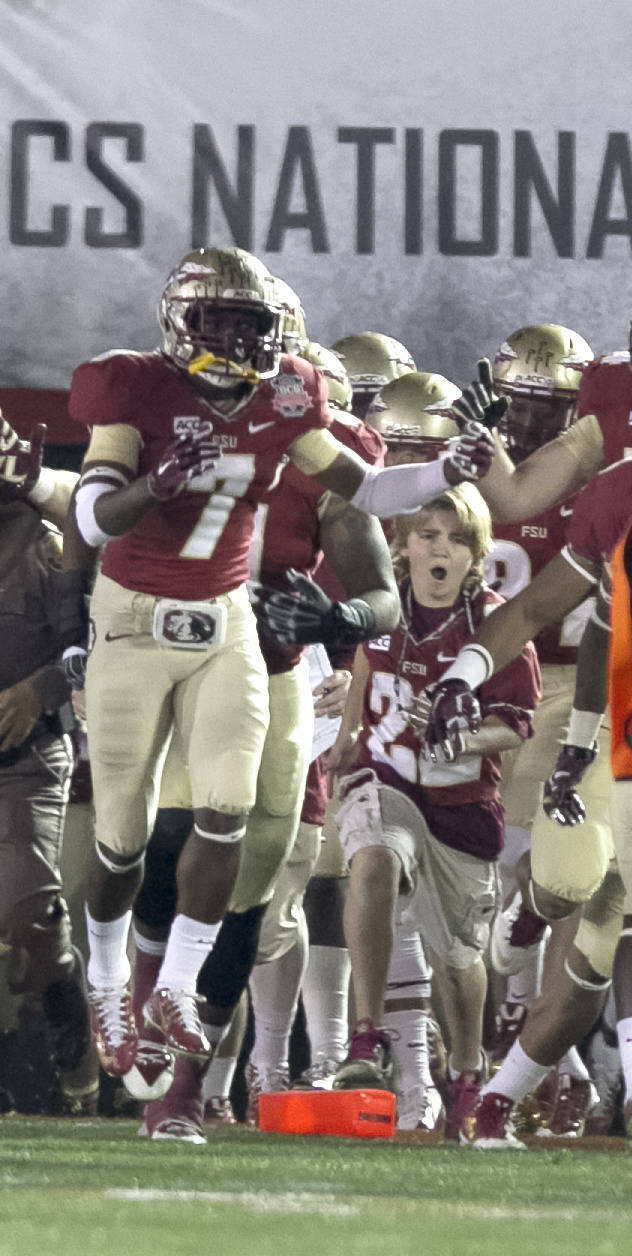 Tre Fisher and Christian Jones leading the team out, BCS Championship, FSU vs Auburn, Rose Bowl, Pasadena, CA,  1-06-14,  (Photo by Steve Musco)