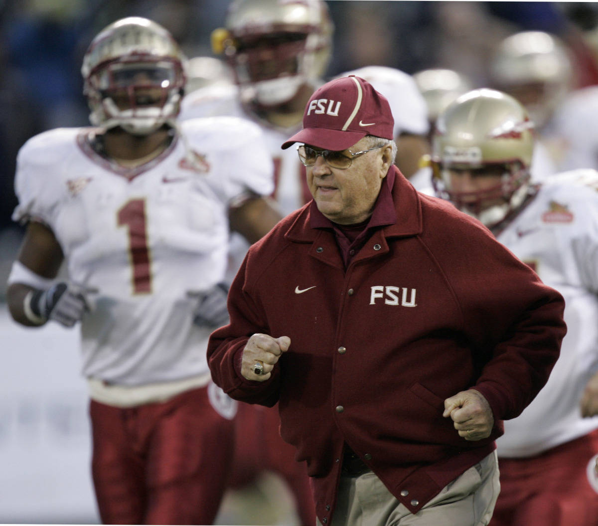 Florida State head coach Bobby Bowden runs unto the field with his team as they get ready to play UCLA at the start the Emerald Bowl college football game in San Francisco, Wednesday, Dec. 27, 2006.(AP Photo/Marcio Jose Sanchez)