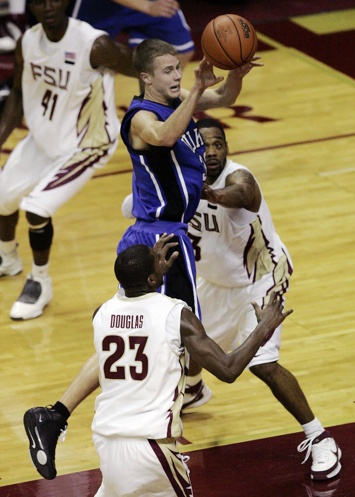 Duke's Jon Scheyer is forced to pass as he tries to penetrate the defense of Florida State's Toney Douglas and Isaiah Swann in the first half of a college basketball game on Wednesday, Jan. 16, 2008 in Tallahassee, Fla.