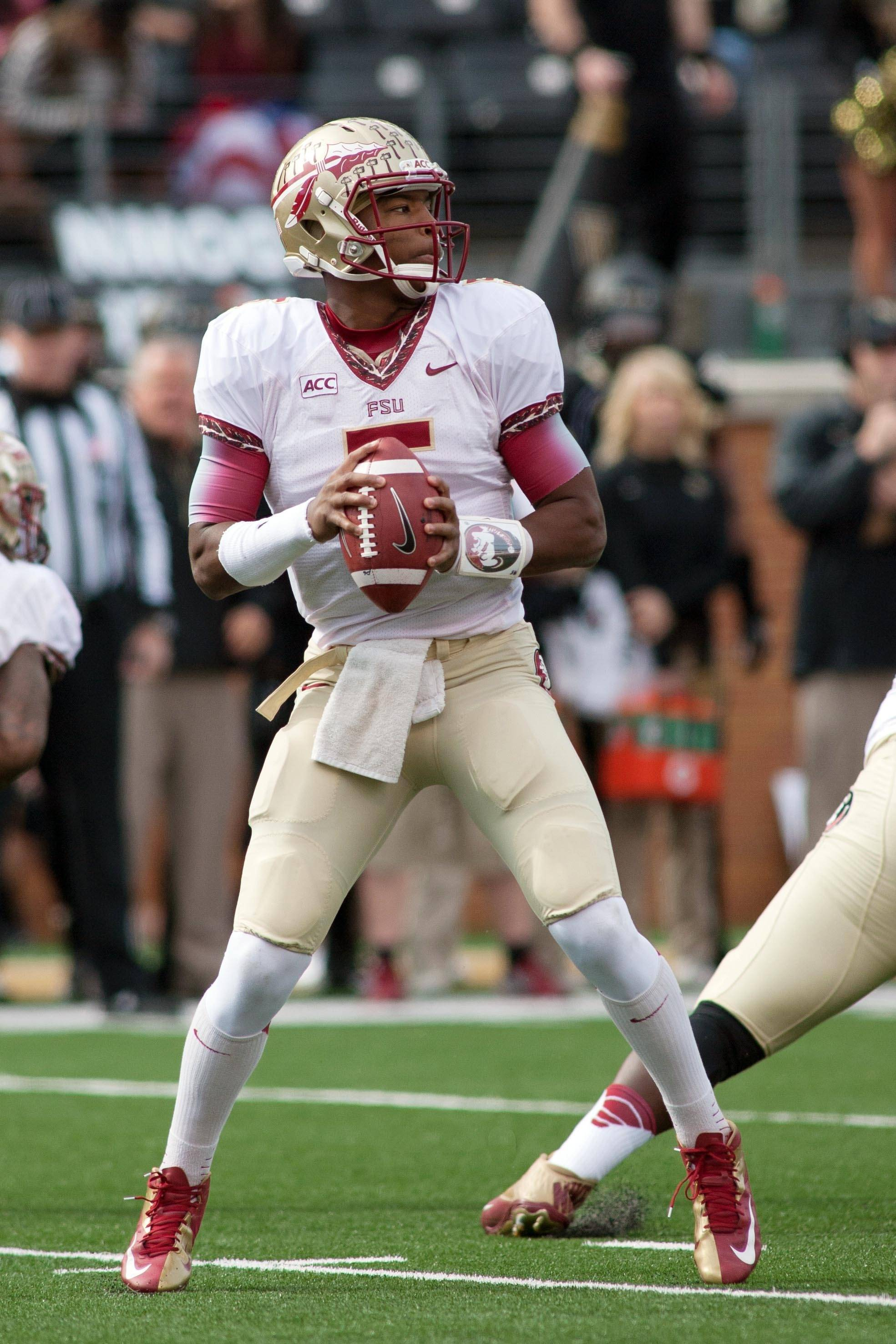 Jameis Winston (5) drops back to pass during the first quarter. Mandatory Credit: Jeremy Brevard-USA TODAY Sports