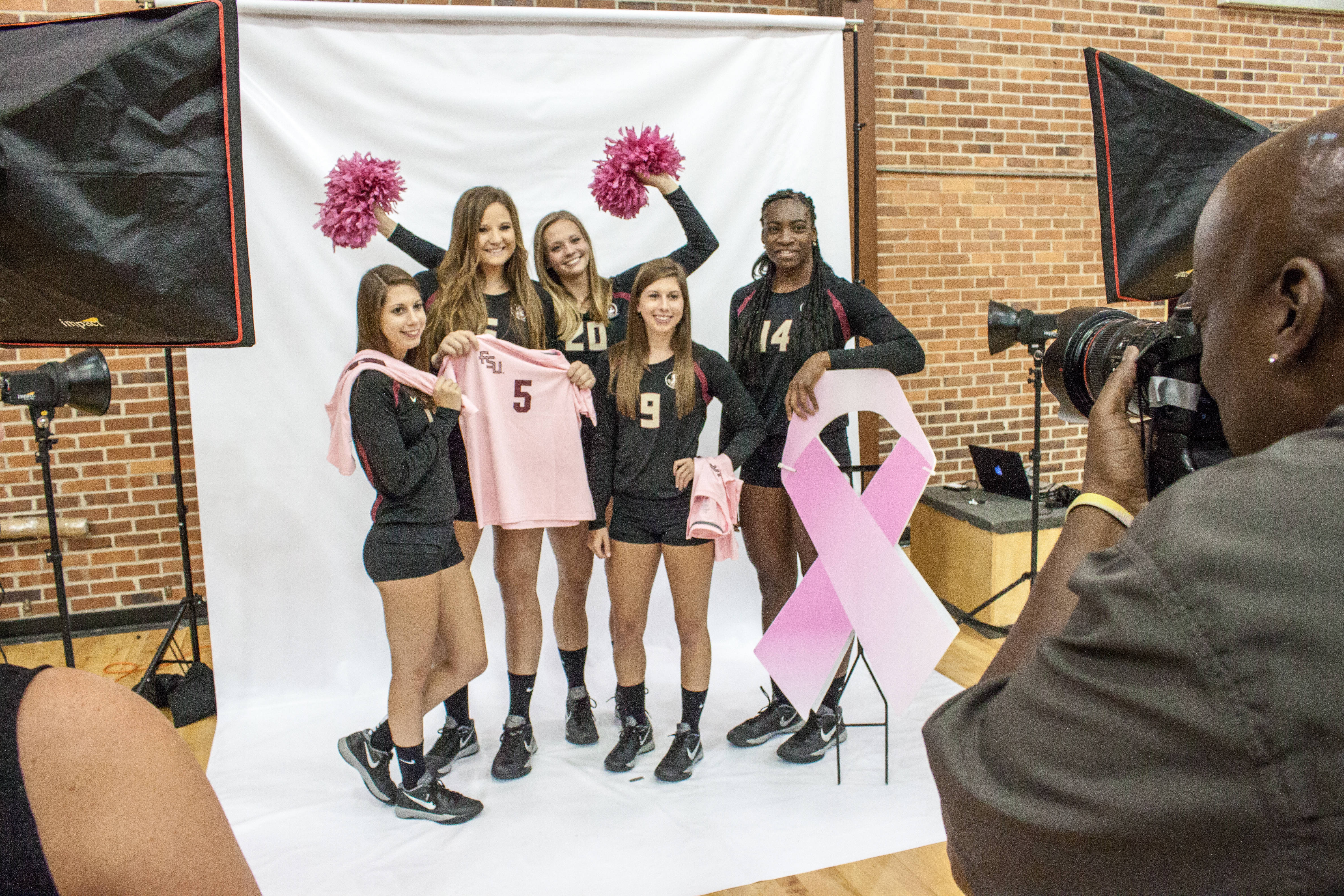 The Seniors pose with some pink items, gearing up for the 2015-16 Paint it Pink campaign.