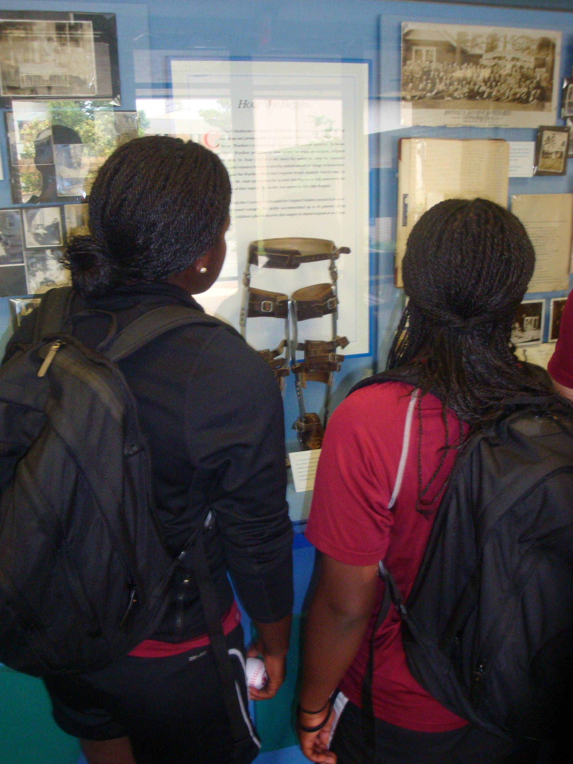 Morgan Bullock (L) and Amber Bryant (R) look at an old children's brace