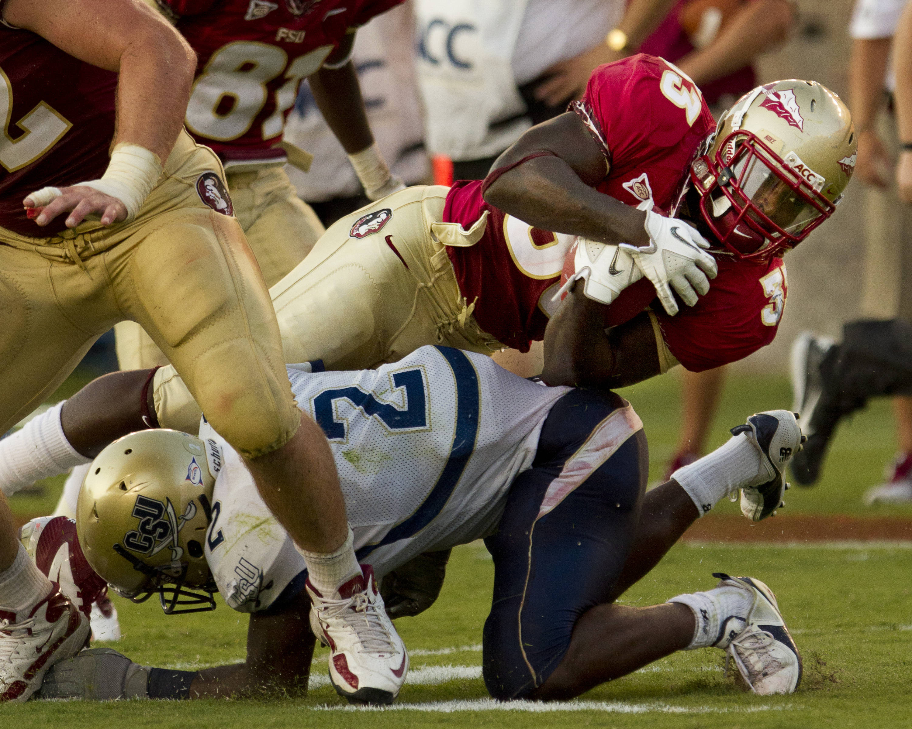 Ty Jones (33) carries the ball downfield during the game against CSU on September 10, 2011.