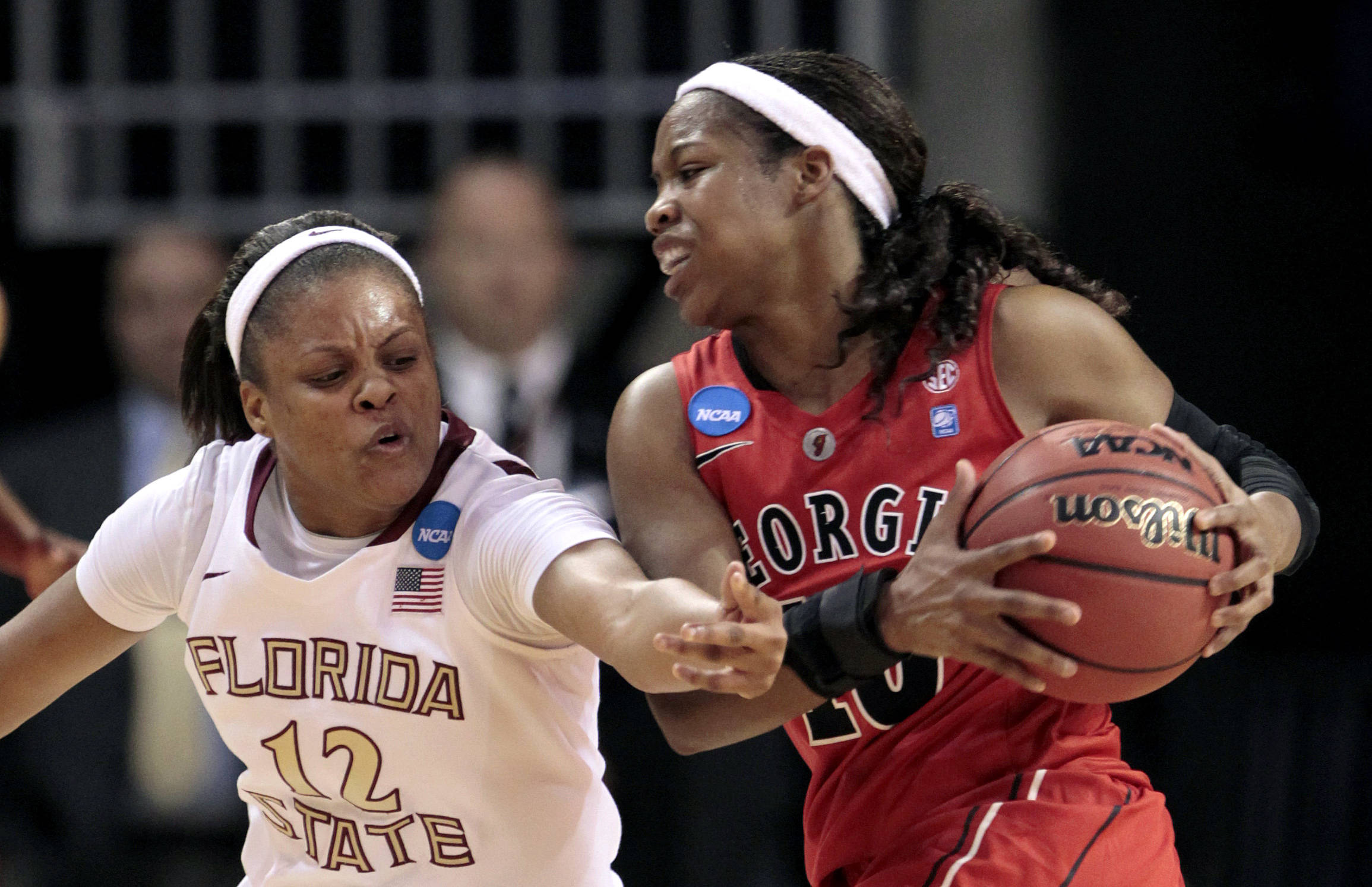 Florida State's Courtney Ward (12) tries to steal the ball from Georgia's Jasmine James (10) in the first half of a second-round NCAA women's college basketball tournament game at Auburn Arena in Auburn, Ala., Tuesday, March 22, 2011. (AP Photo/Dave Martin)