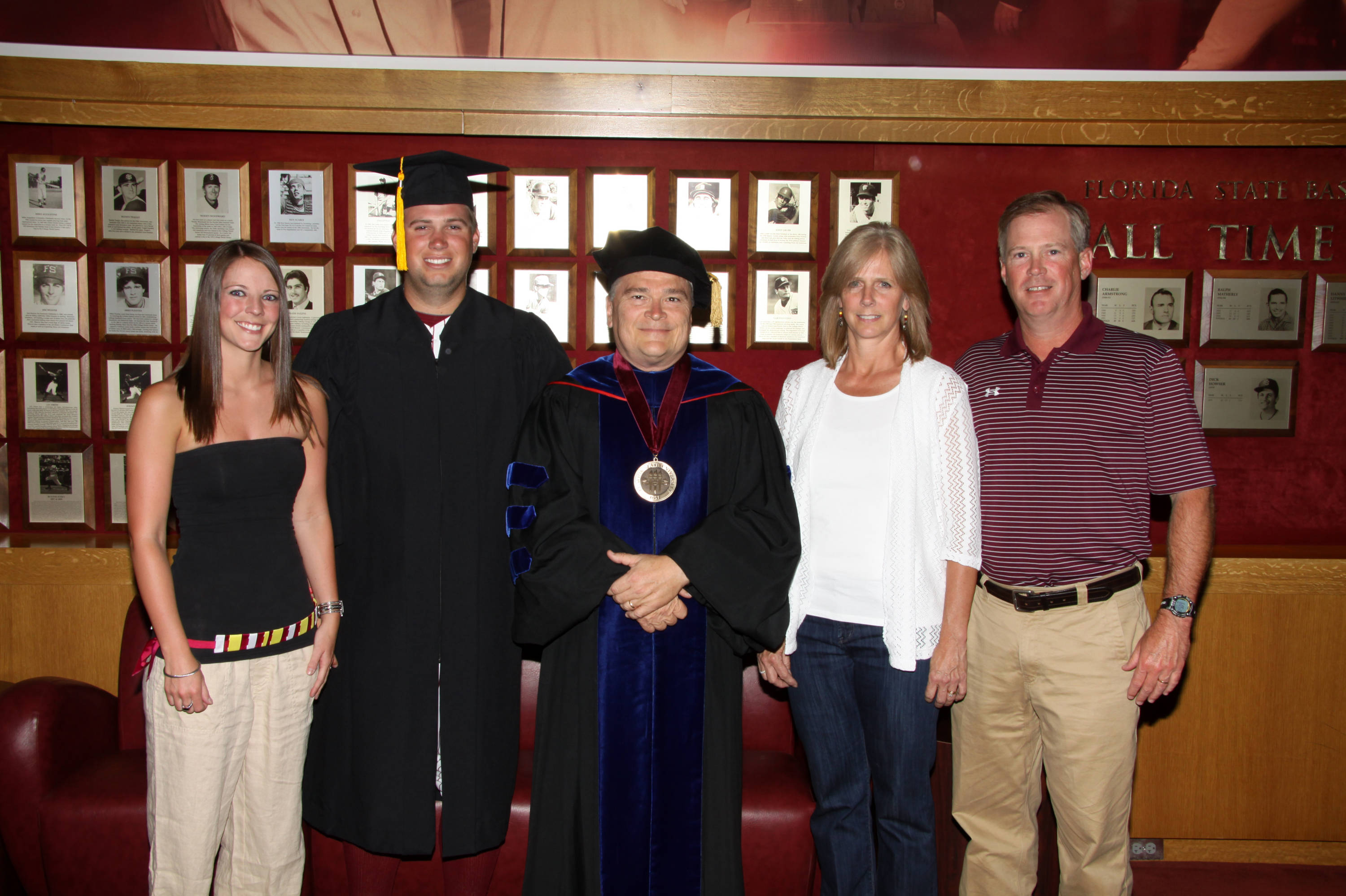 2011 Spring Graduation Ceremony held at Dick Howser Stadium to honor the graduating baseball seniors. Jack Posey (5) with family and President Barron