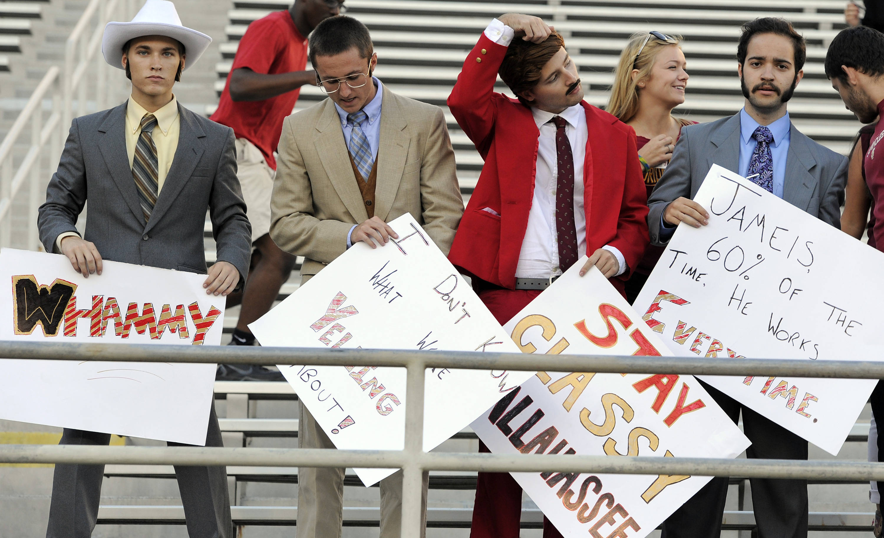 Florida State Seminoles fans dressed up as the Channel 4 news team from the movie Anchorman get set up before the game against the Miami Hurricanes at Doak Campbell Stadium. Mandatory Credit: John David Mercer-USA TODAY Sports