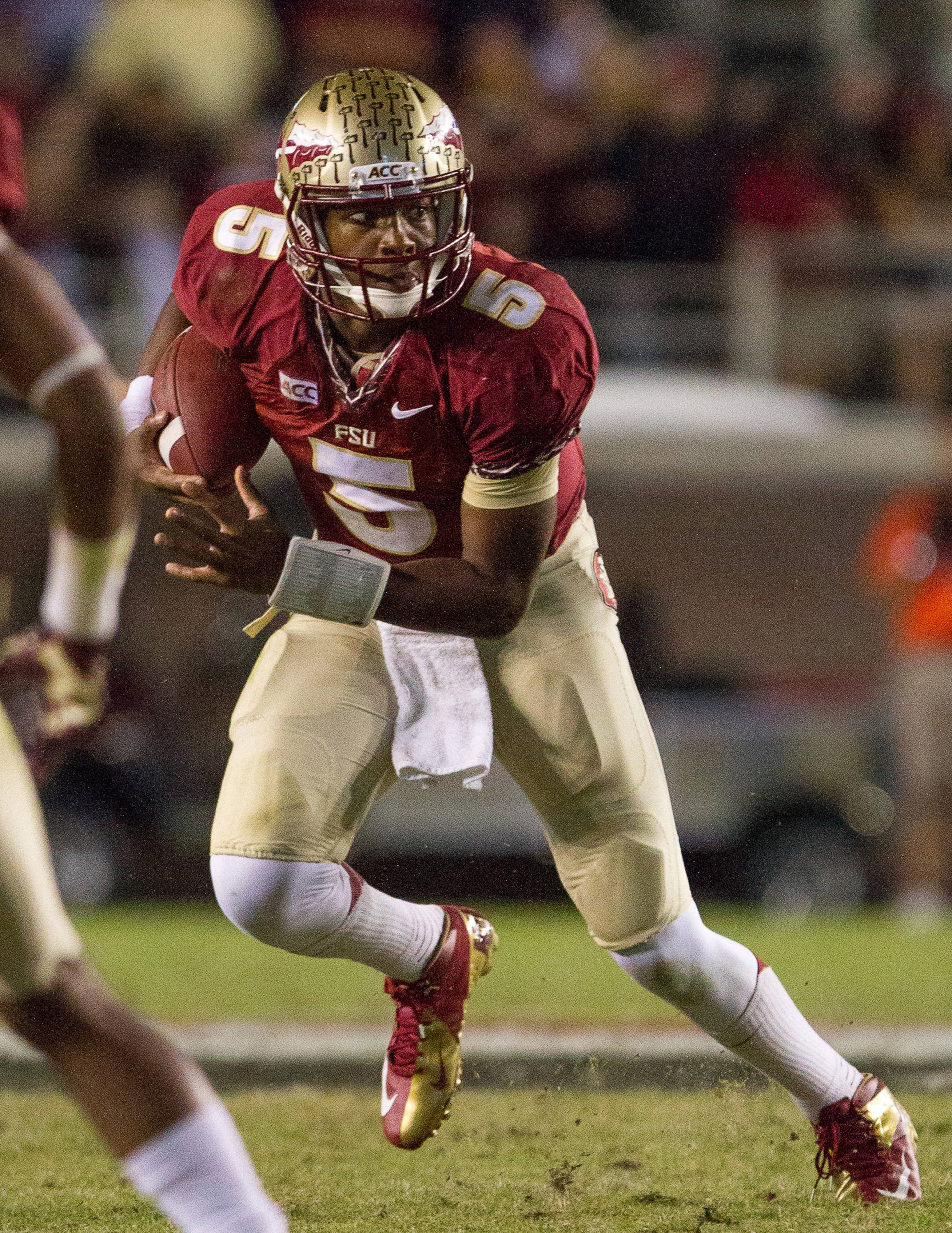 Jameis Winston (5) carries the ball during FSU football's 41-14 win over Miami on Saturday, November 2, 2013 in Tallahassee, Fla. Photo by Michael Schwarz.