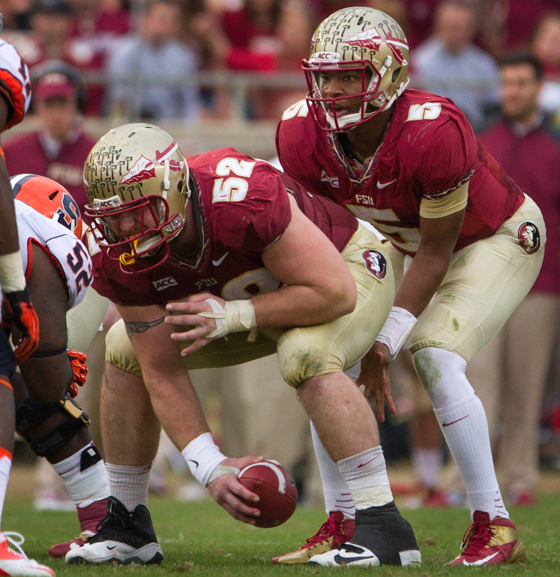 Bryan Stork (52) snaps the ball to Jameis Winston (5) during FSU Football's 59-3 win over Syracuse on Saturday, November 16, 2013 in Tallahassee, Fla. Photo by Mike Schwarz.