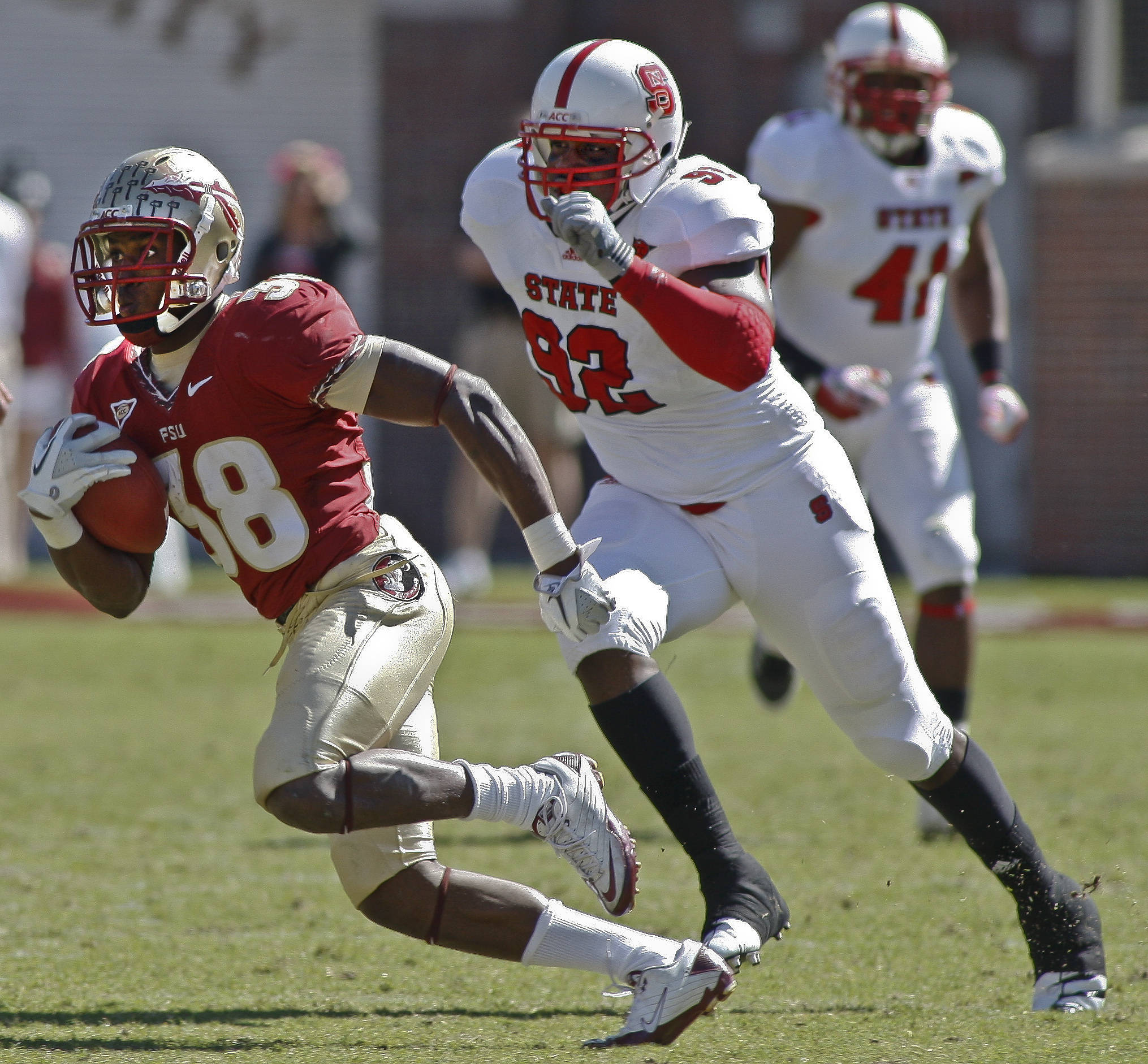 Florida State running back Jermaine Thomas (38) takes off on a 32-yard catch and run as North Carolina State defensive end Darryl Cato-Bishop (92) tries to catch him. (AP Photo/Phil Sears)