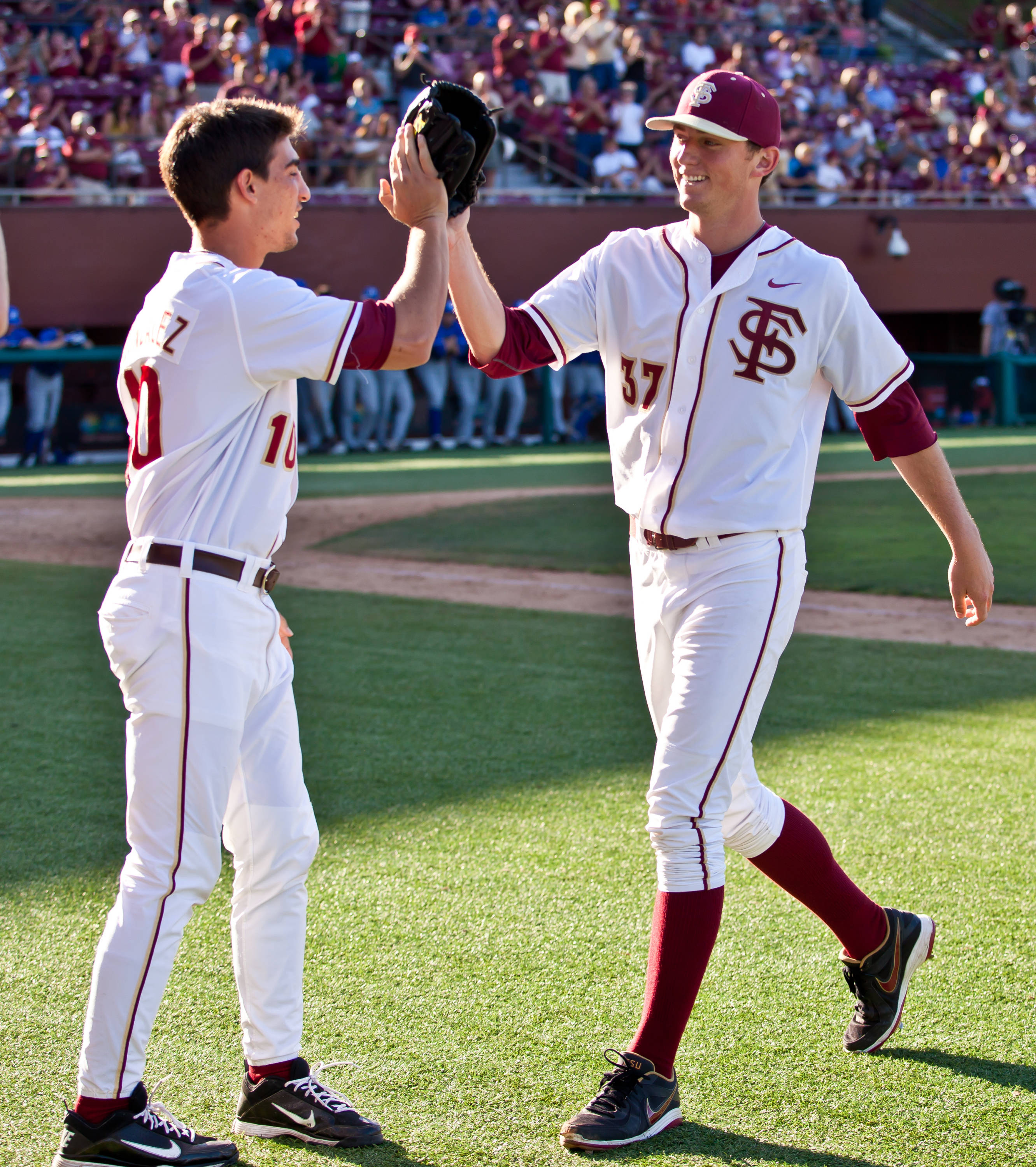 Justin Gonzalez congratulates Brandon Leibrandt on a strong performance Saturday in game one.