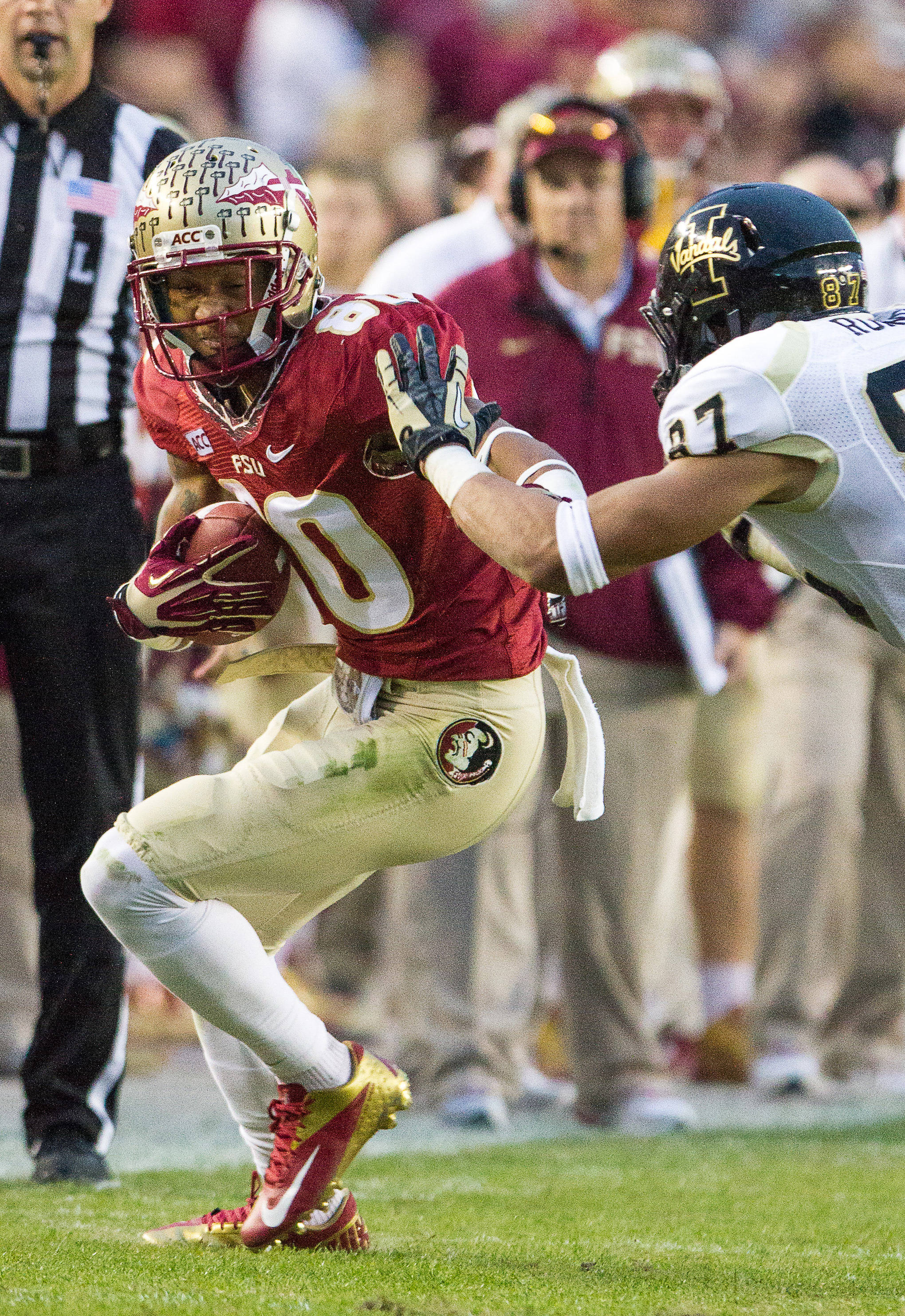 Rashad Greene (80) pushes a defender while carrying the ball during FSU Football's 80-14 victory over Idaho in Tallahassee, Fla on Saturday, November 23, 2013. Photos by Mike Schwarz.
