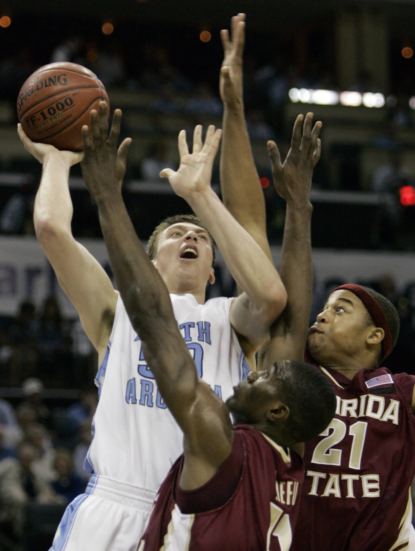 North Carolina's Tyler Hansbrough shoots over a doubleteam by Uche Echefu, center, and Julian Vaughn in the first half. (AP Photo/Gerry Broome)