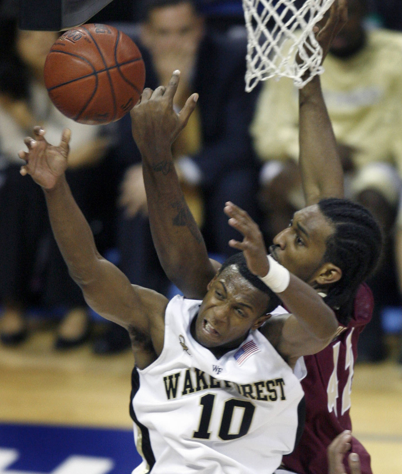 Wake Forest's Ishmael Smith and Ryan Reid fight for a rebound in the first half. (AP Photo/Rick Havner)