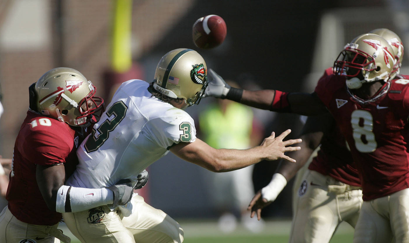 UAB quarterback Sam Hunt, center, gets a pass away despite the sack attempt by Florida State's Geno Hayes, left, as Florida State defensive back Roger Williams, right, reaches for the ball during the first quarter of a football game Saturday, Sept. 8, 2007, in Tallahassee, Fla. The pass was incomplete. (AP Photo/Phil Coale)