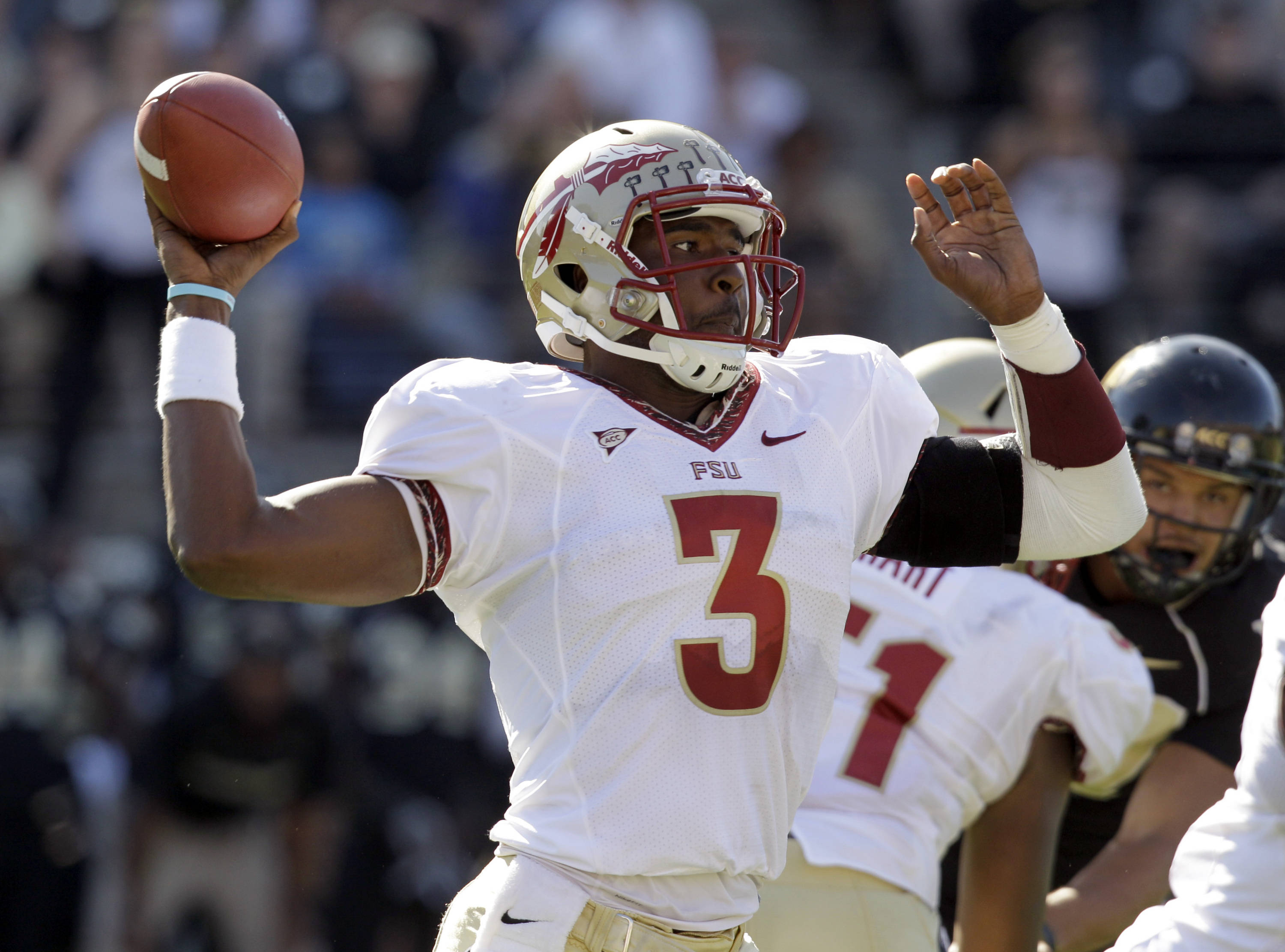 Florida State's EJ Manuel (3) throws a pass against the Wake Forest. (AP Photo/Chuck Burton)