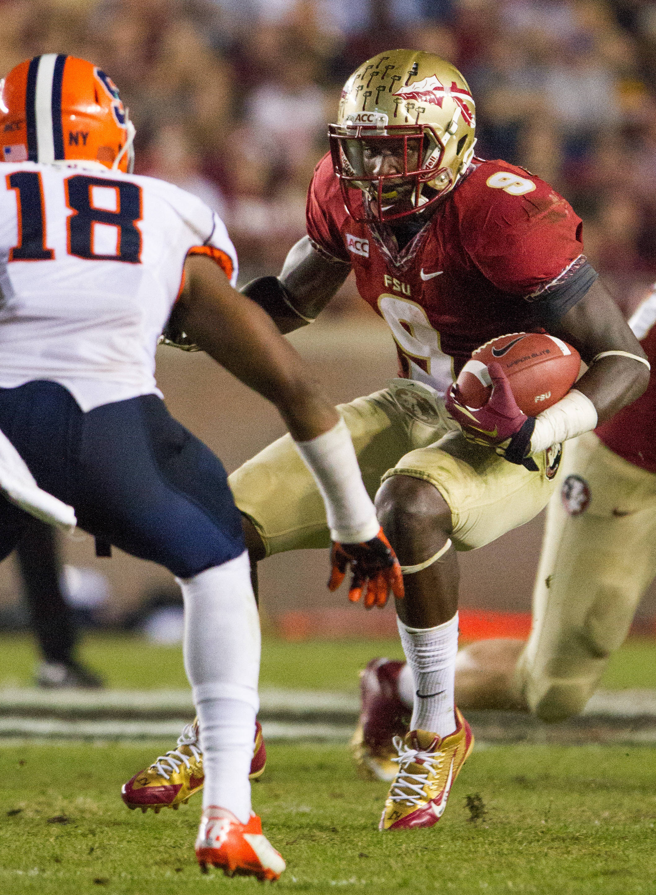 Karlos Williams (9) runs the ball during FSU Football's 59-3 win over Syracuse on Saturday, November 16, 2013 in Tallahassee, Fla. Photo by Mike Schwarz.
