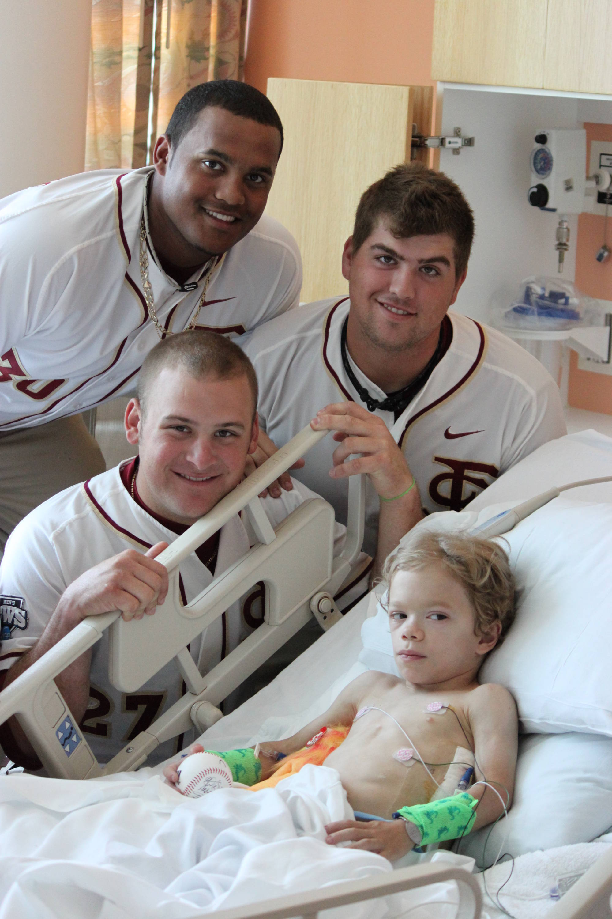 Hunter Scantling, Stuart Tapley and Brian Busch on a visit to the Children's Hospital in Omaha