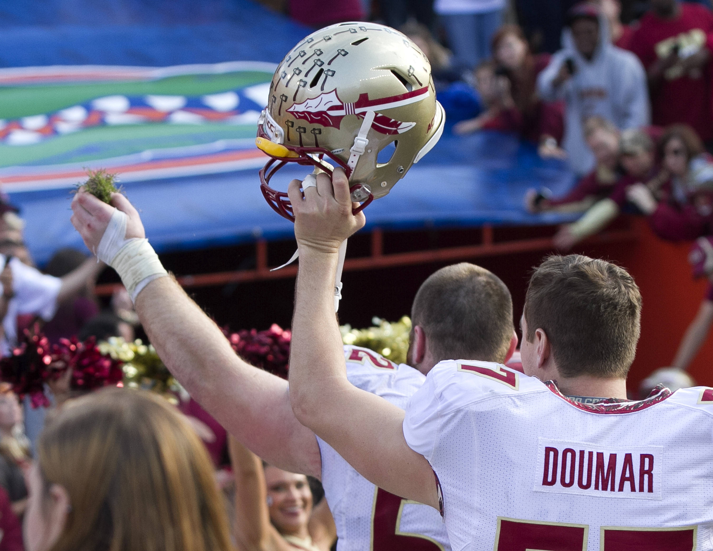Bryan Stork (52) with a new addition to the sod cemetary, FSU vs Florida, 11-30-13,  (Photo by Steve Musco)