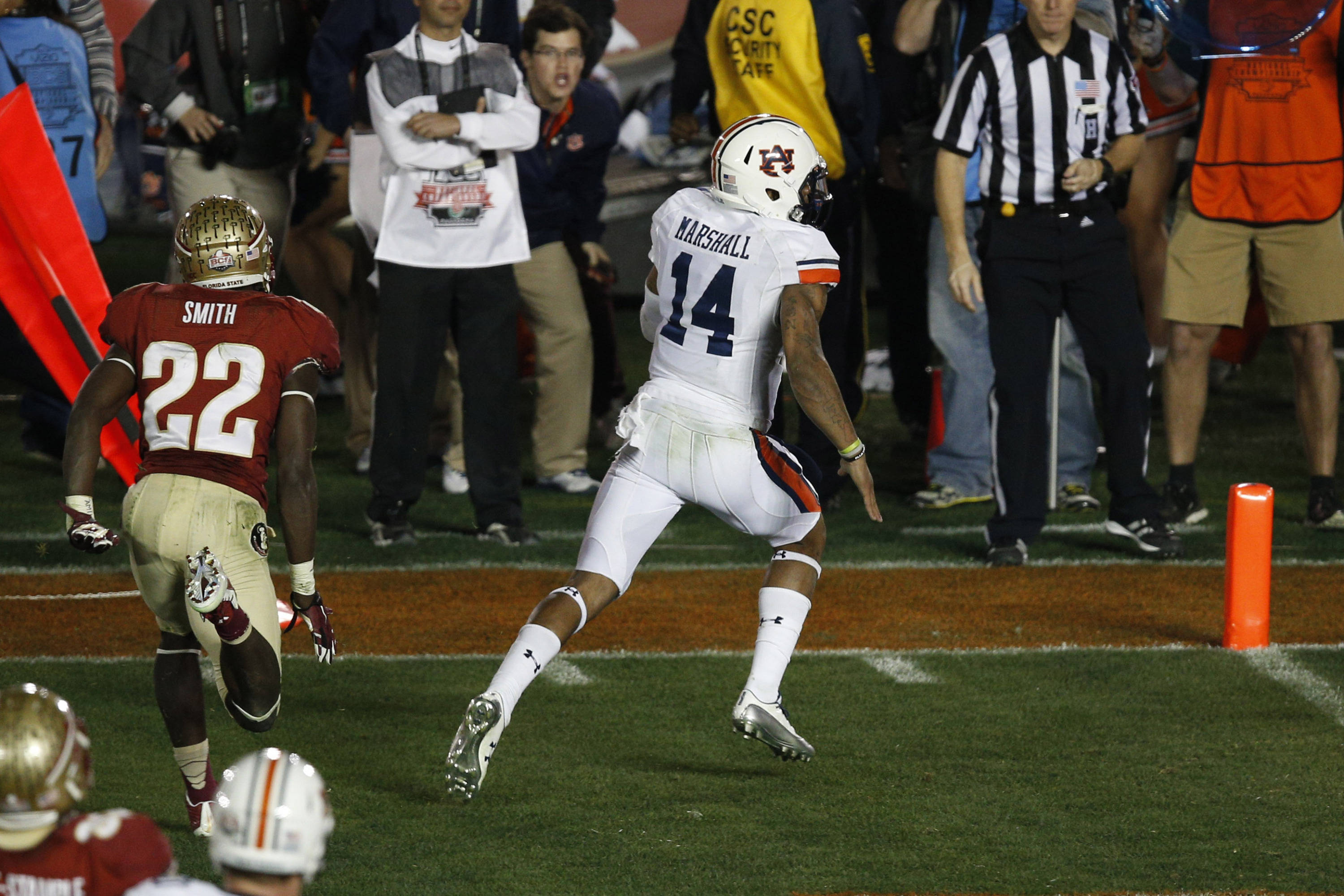 Jan 6, 2014; Pasadena, CA, USA; Auburn Tigers quarterback Nick Marshall (14) scores a touchdown past Florida State Seminoles linebacker Telvin Smith (22) during the first half of the 2014 BCS National Championship game at the Rose Bowl.  Mandatory Credit: Kelvin Kuo-USA TODAY Sports