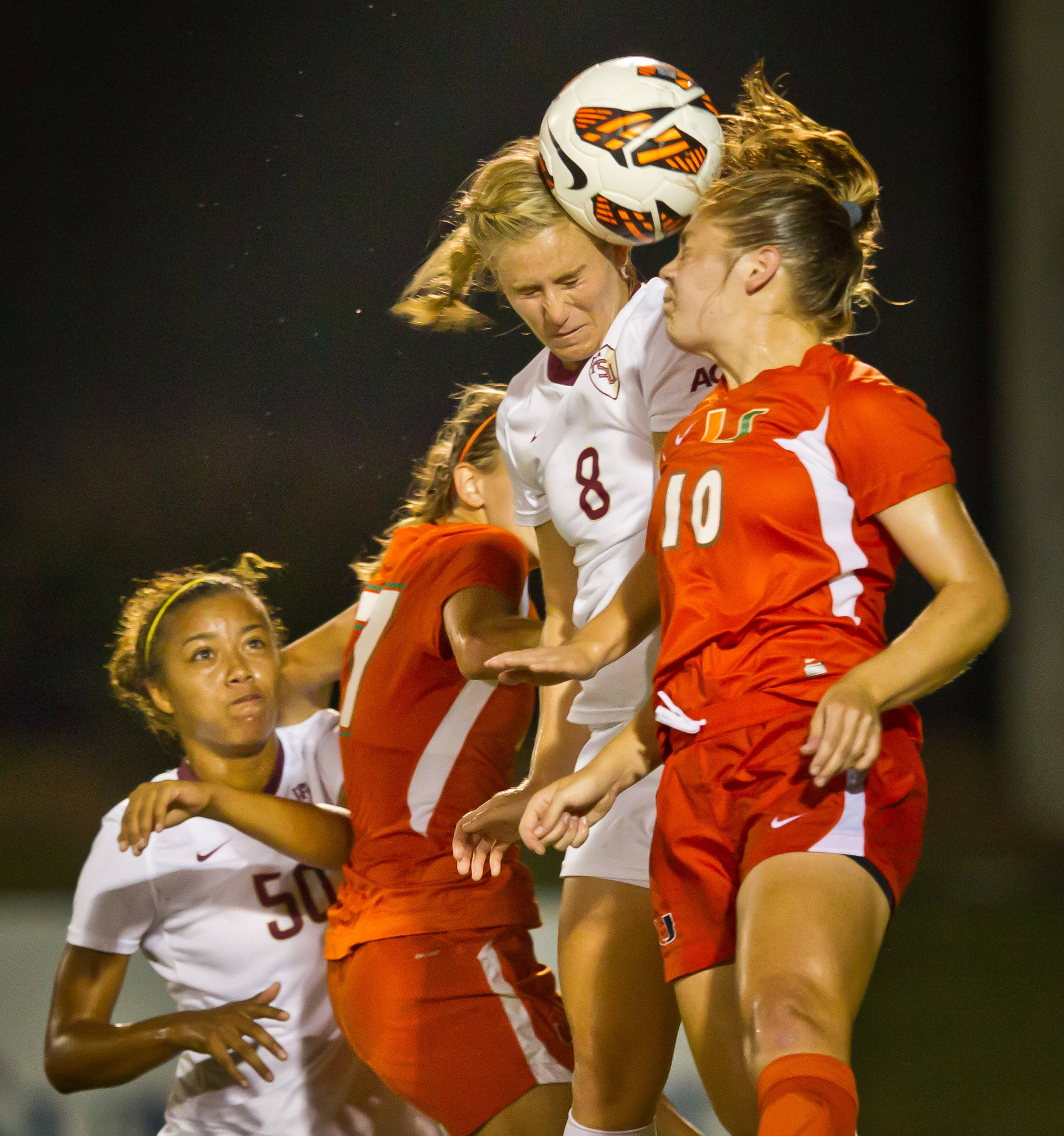 Michaela Hahn (8) battles the Canes Betsy Middleton for a header near the UM goal.#$%^#$%^Photo by Ross Obley