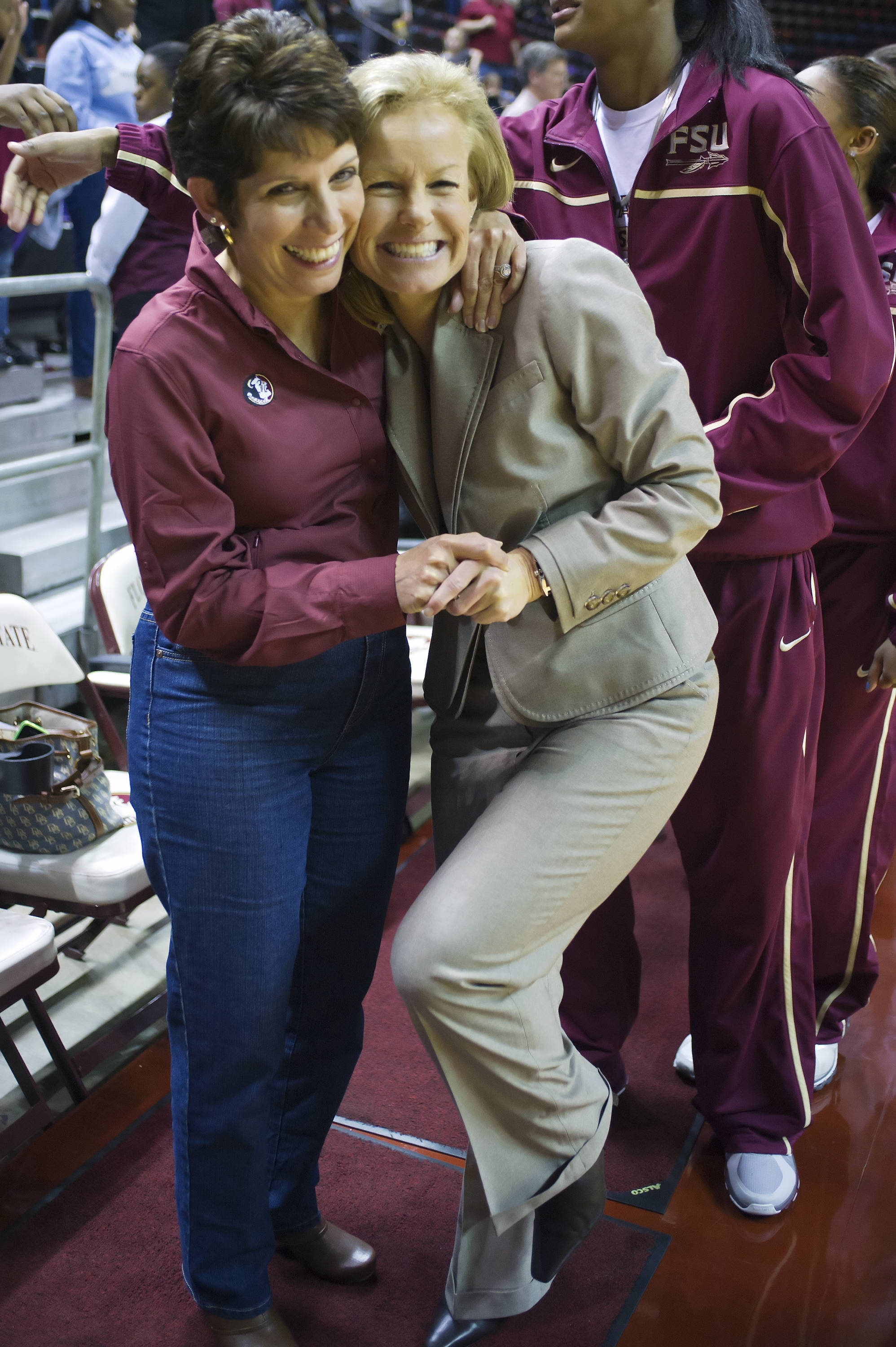 Sue Semrau is congratulated by an FSU fan after the game