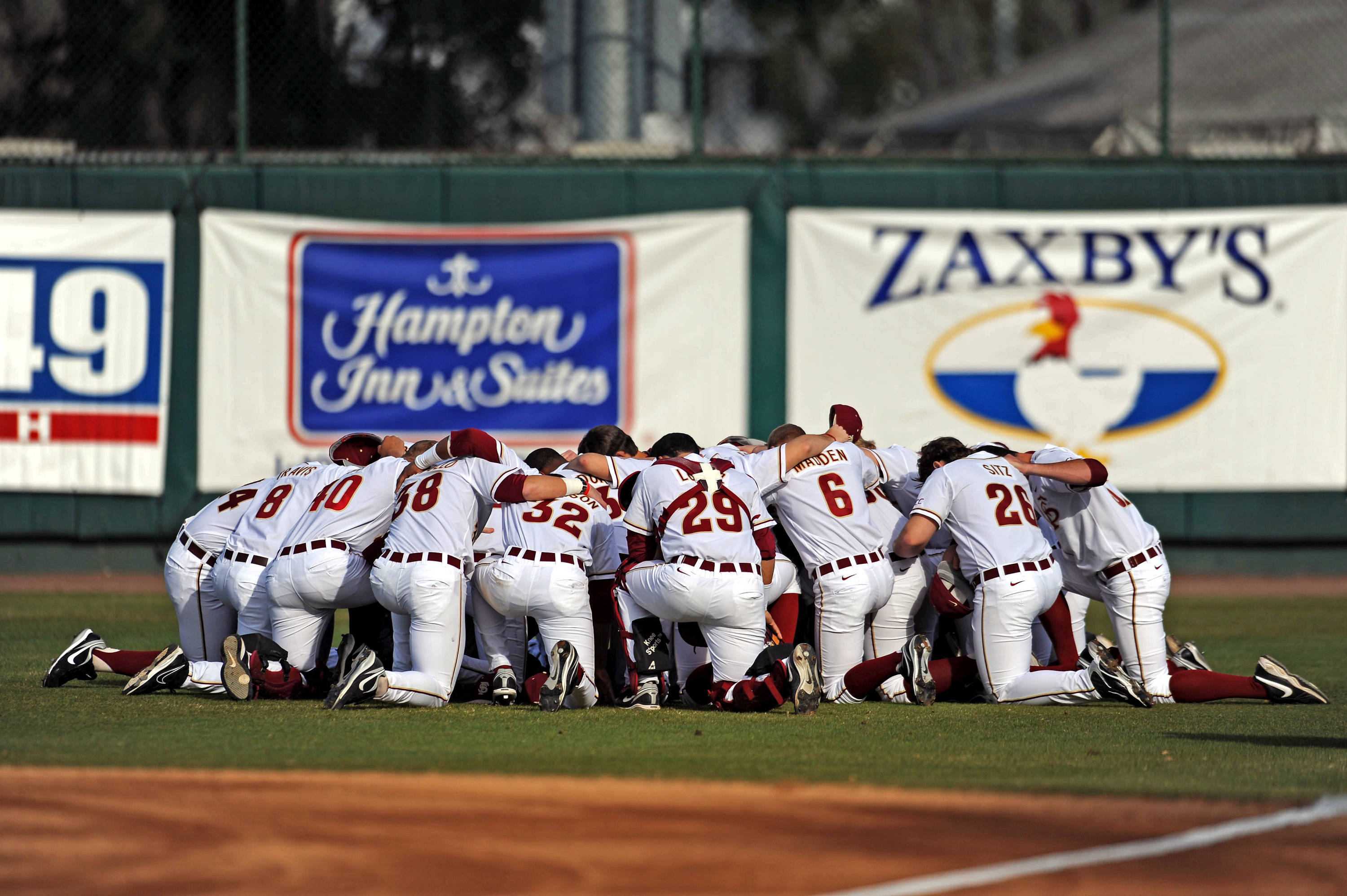 The Seminoles huddle before the start of Friday's opening day game against Georgia State.