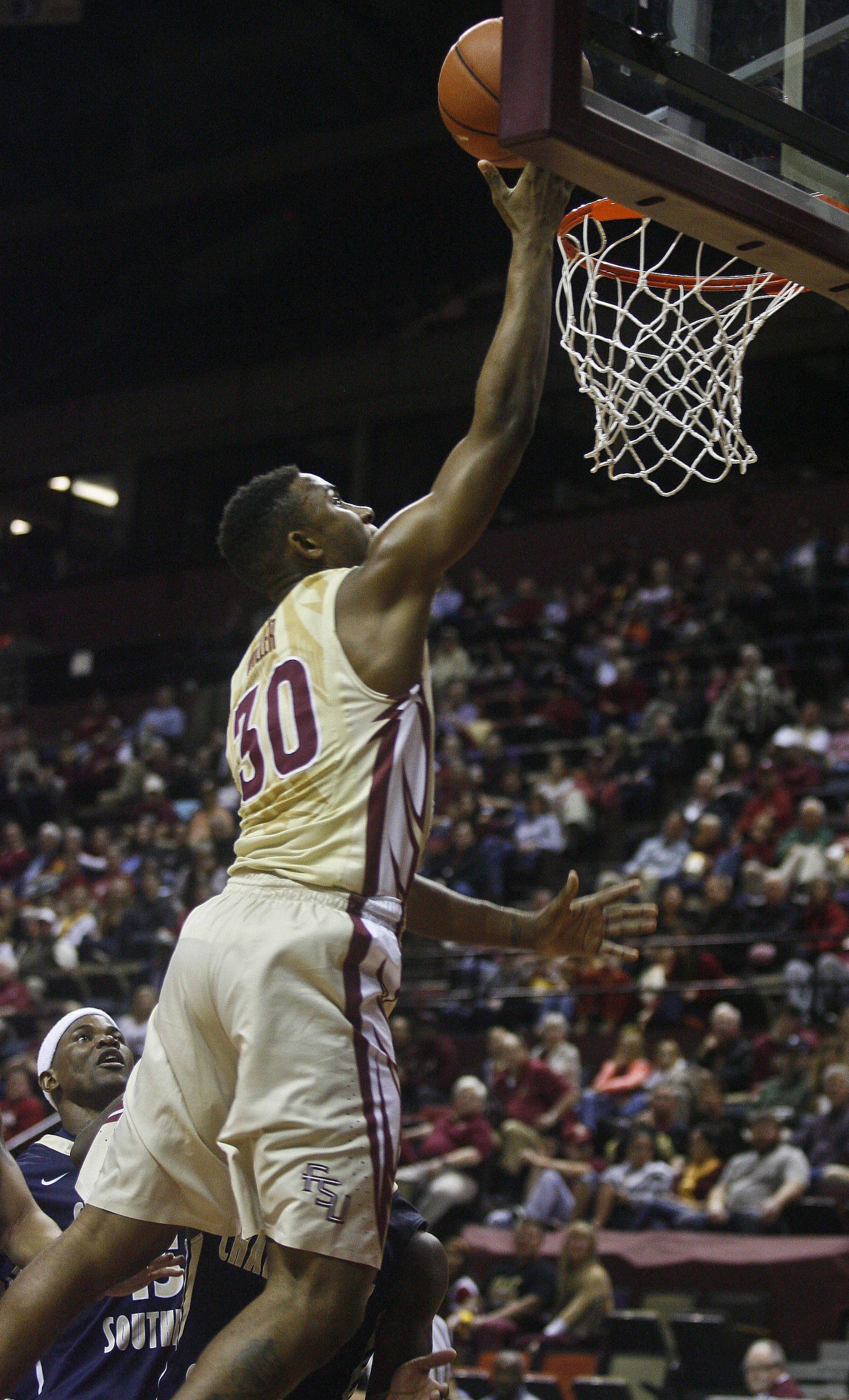 Florida State Seminoles guard Ian Miller (30) shoots the ball in the first half. (Phil Sears-USA TODAY Sports)